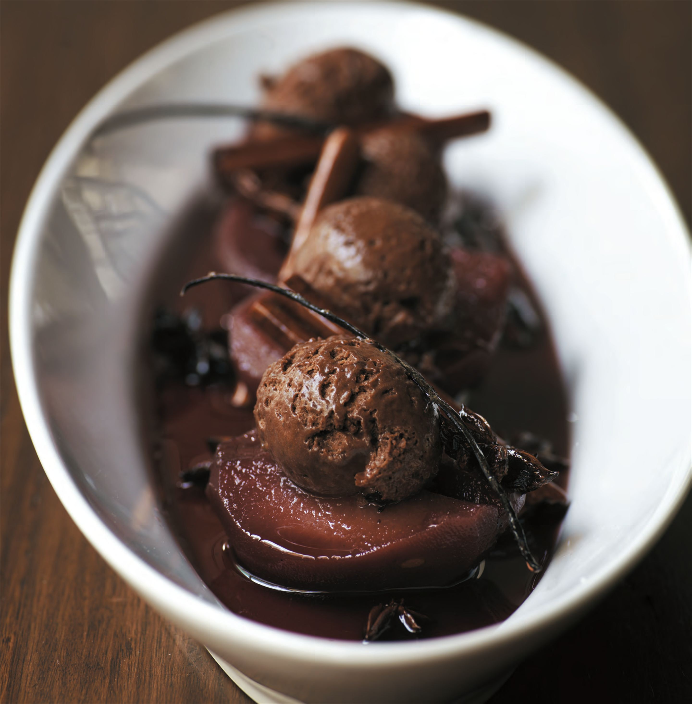 Quinces poached in spiced wine with chestnut and chocolate mousse