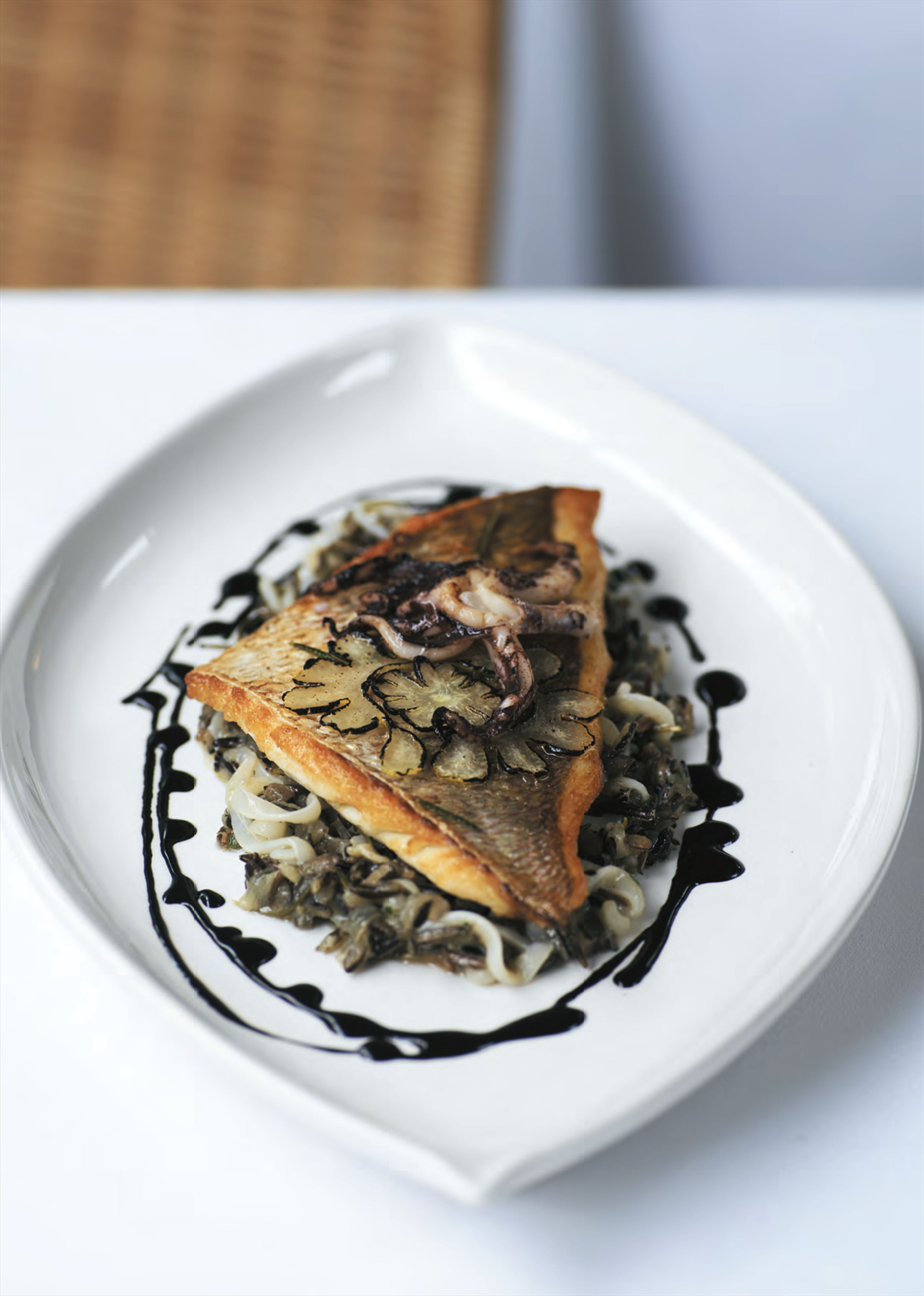 Roasted snapper with braised wild rice and calamari with ink sauce