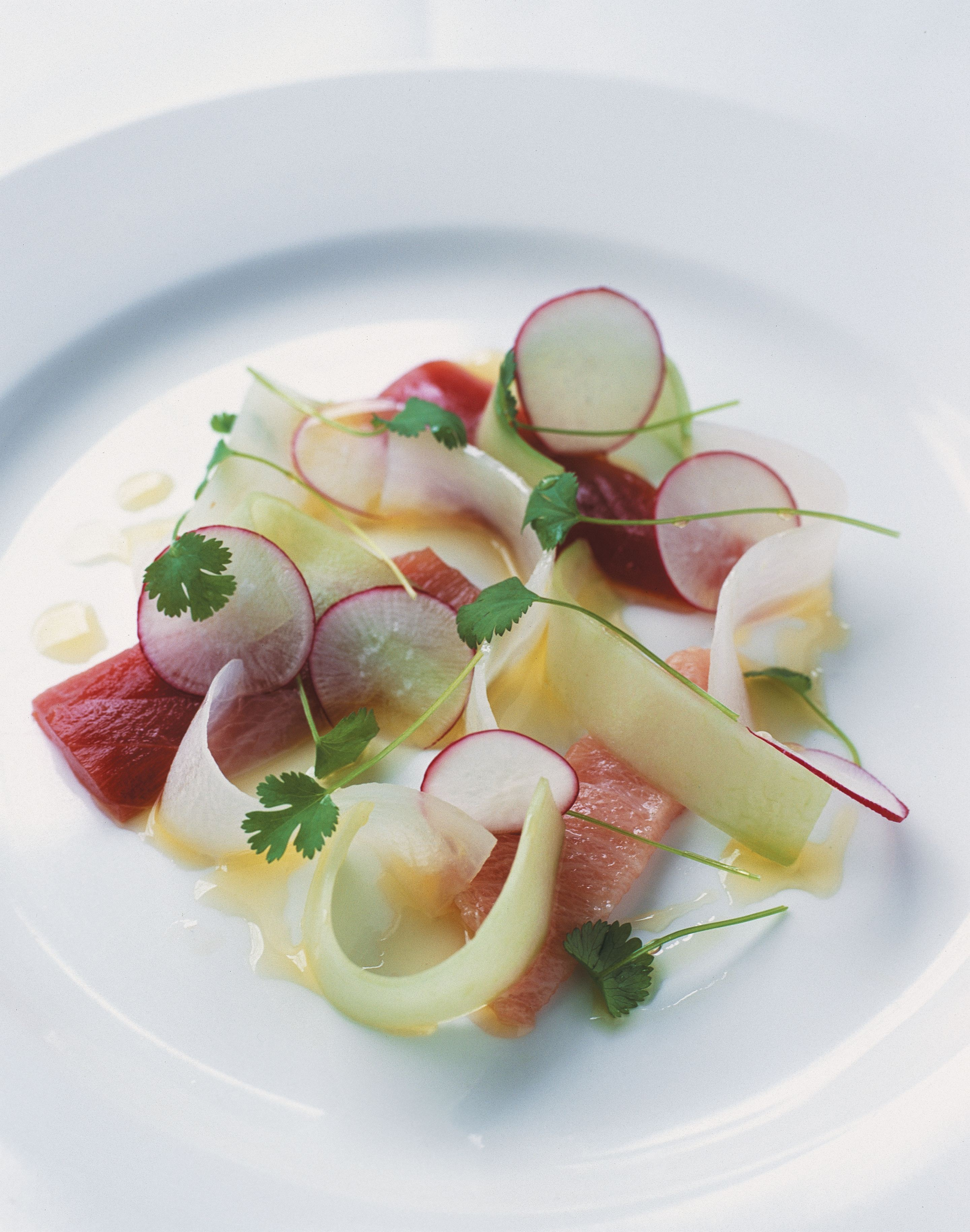 Sashimi of bluefin tuna with pickled white radish, cucumber and baby coriander
