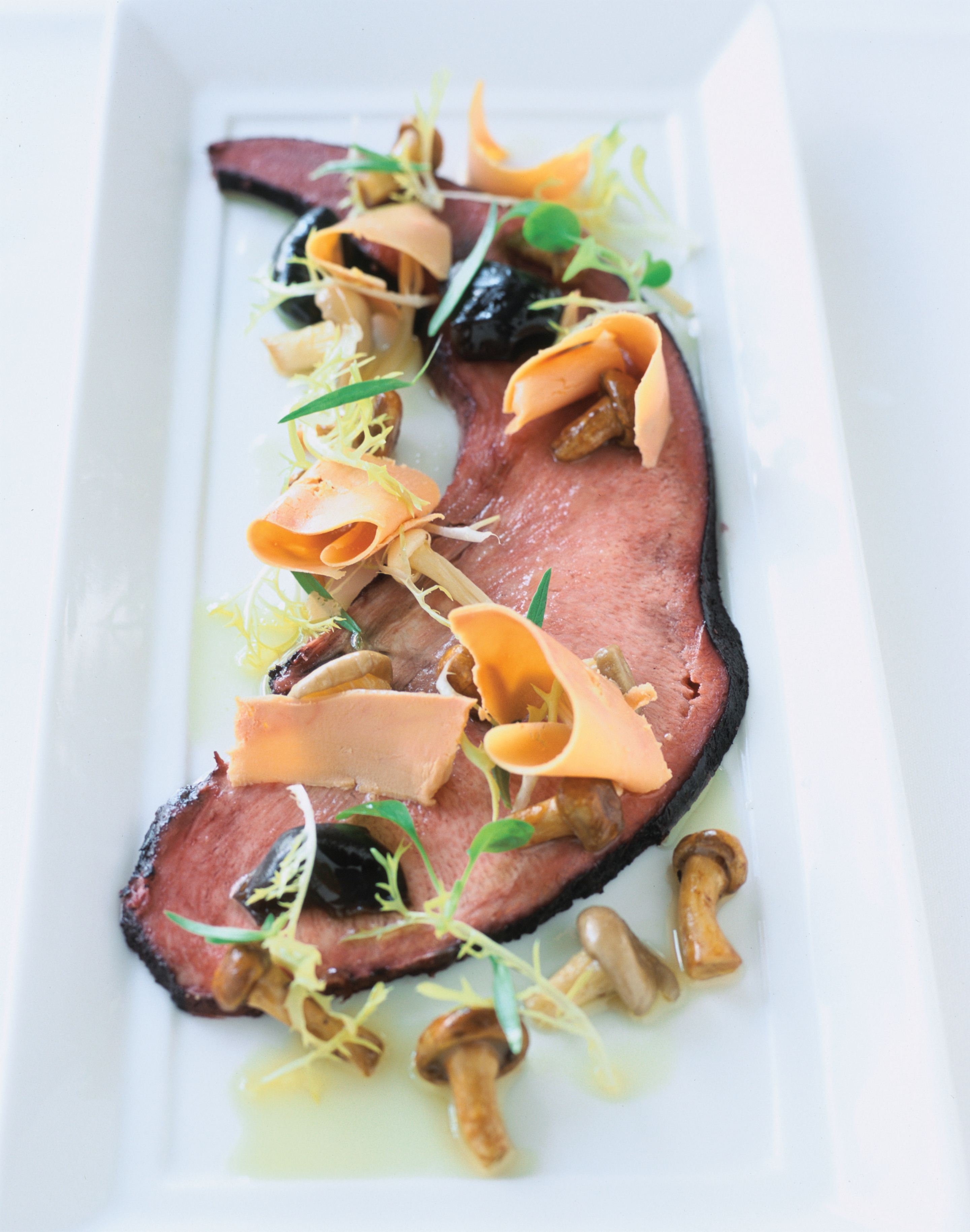 Pickled wagyu tongue with mushrooms à la grecque and shaved foie gras