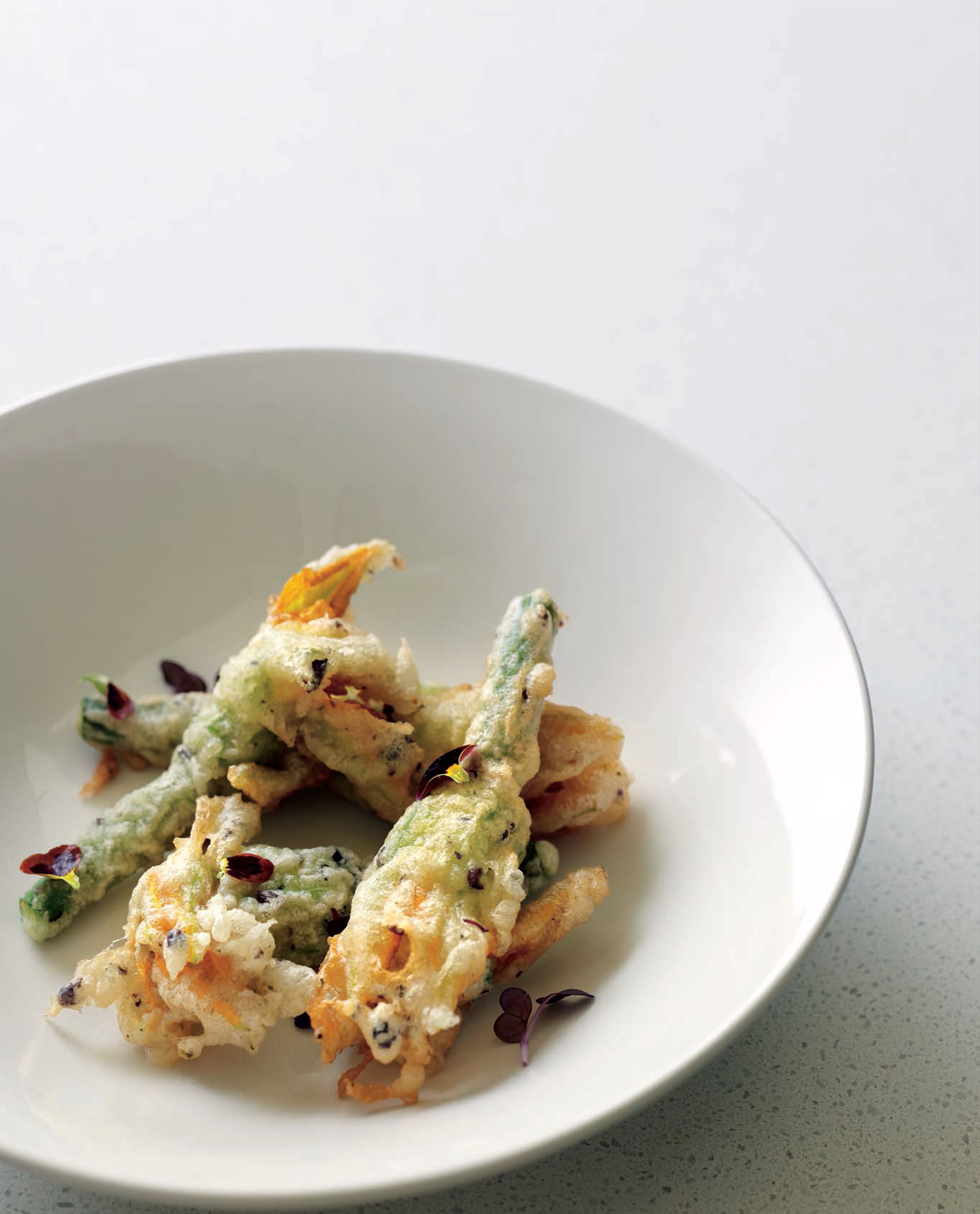 Crunchy zucchini flowers stuffed with haloumi, mint and ginger