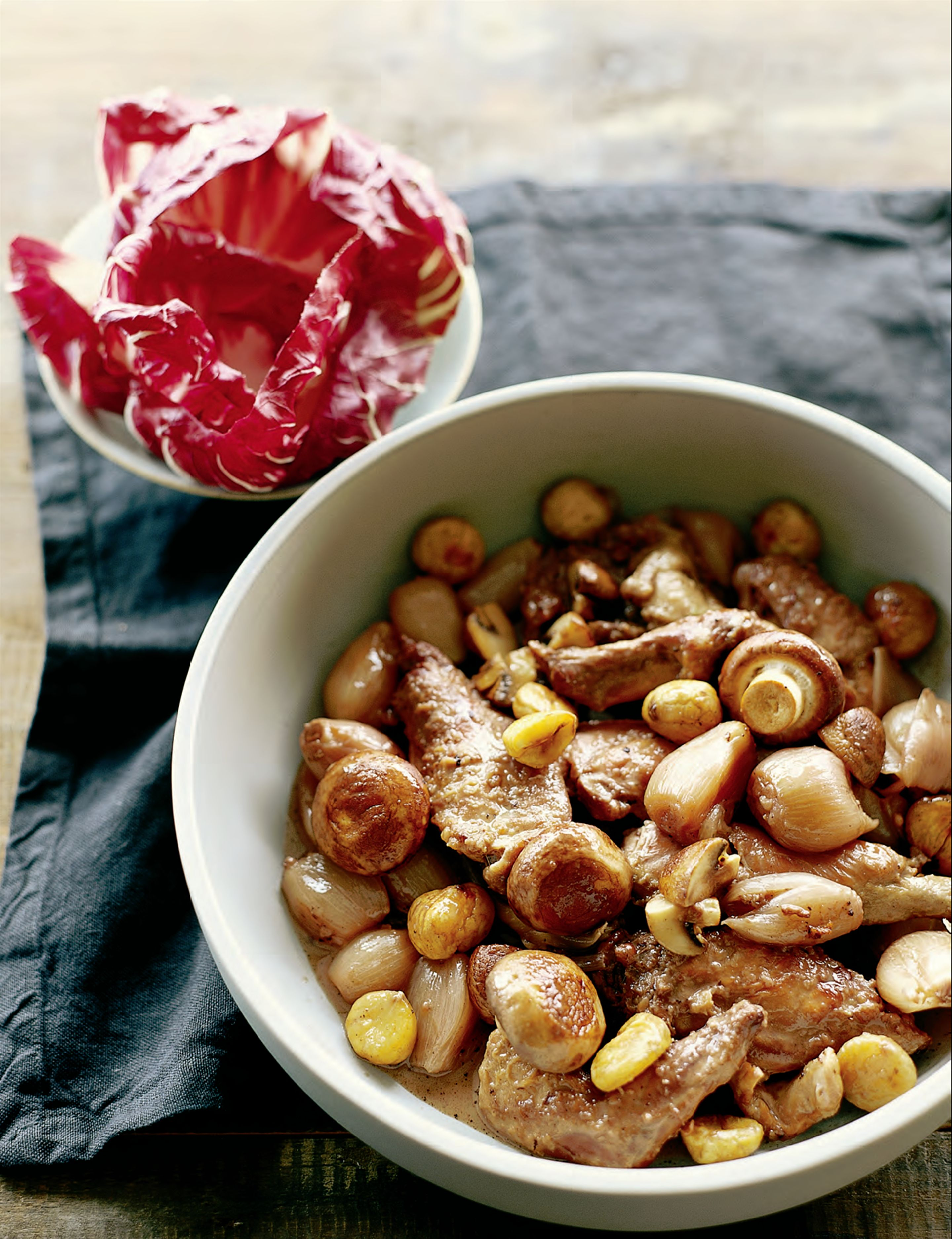Braised rabbit with mushrooms, chestnuts and shallots