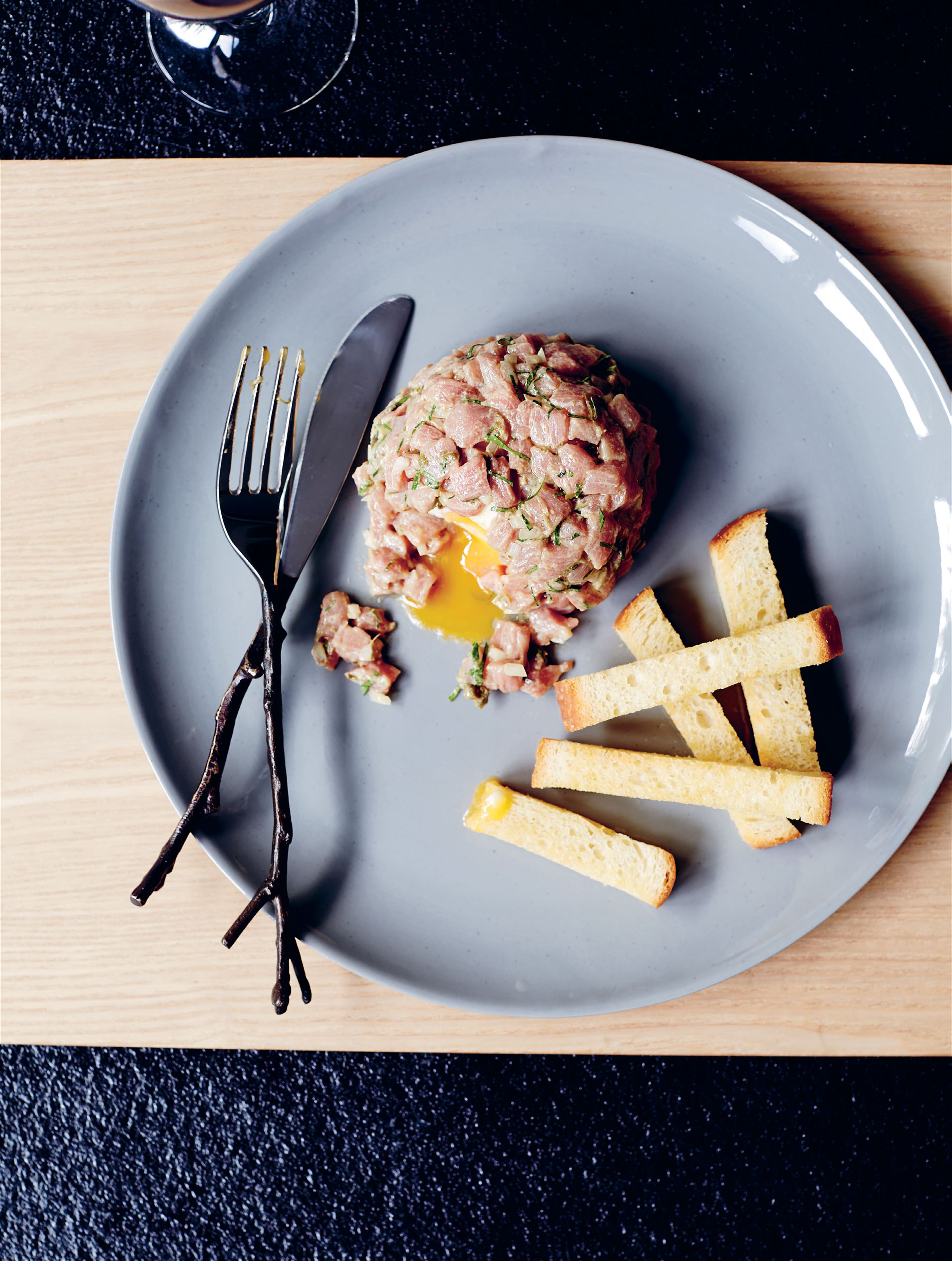 Veal tartare with soft-boiled egg & brioche soldiers