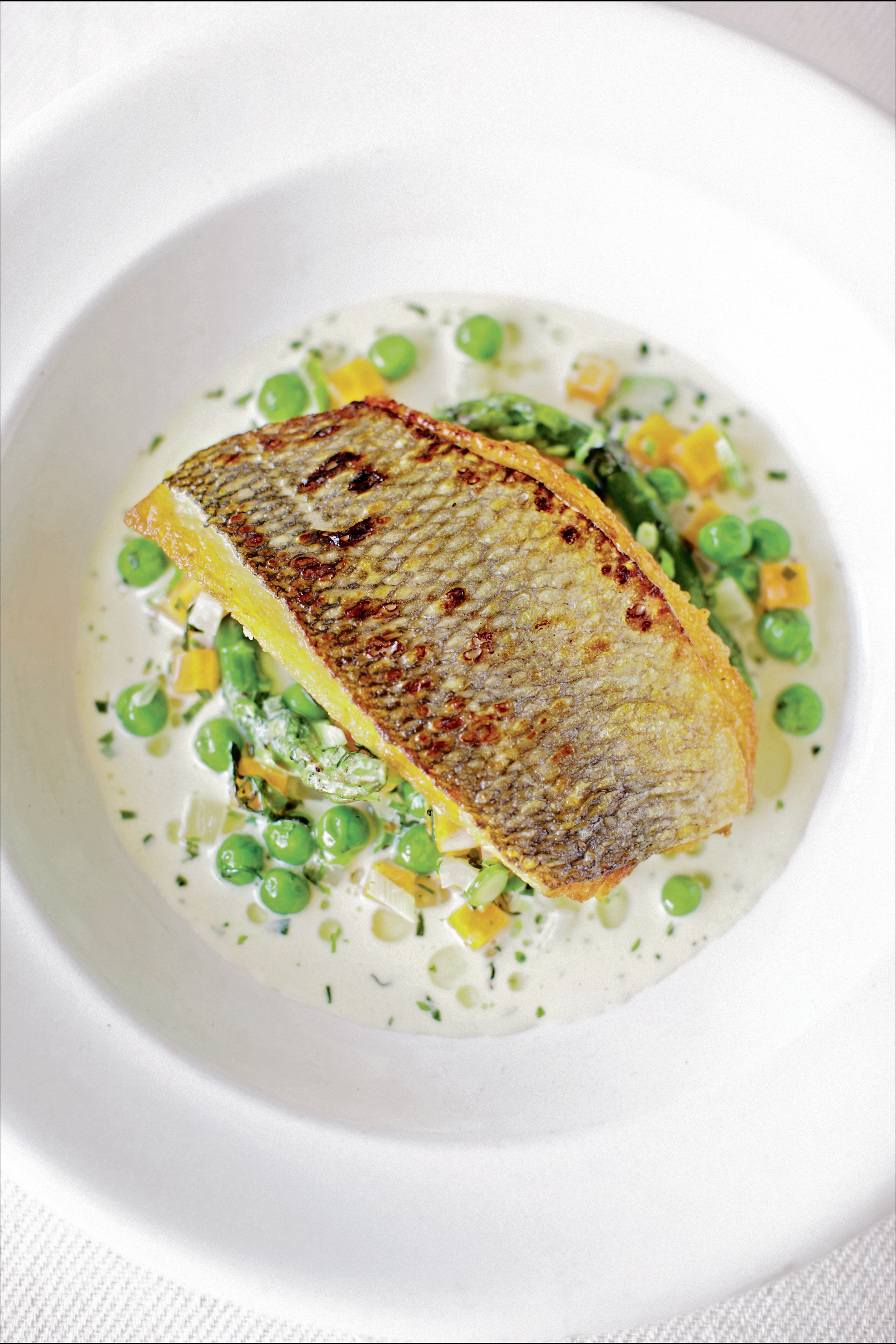 Pan-fried bream with spring vegetable nage