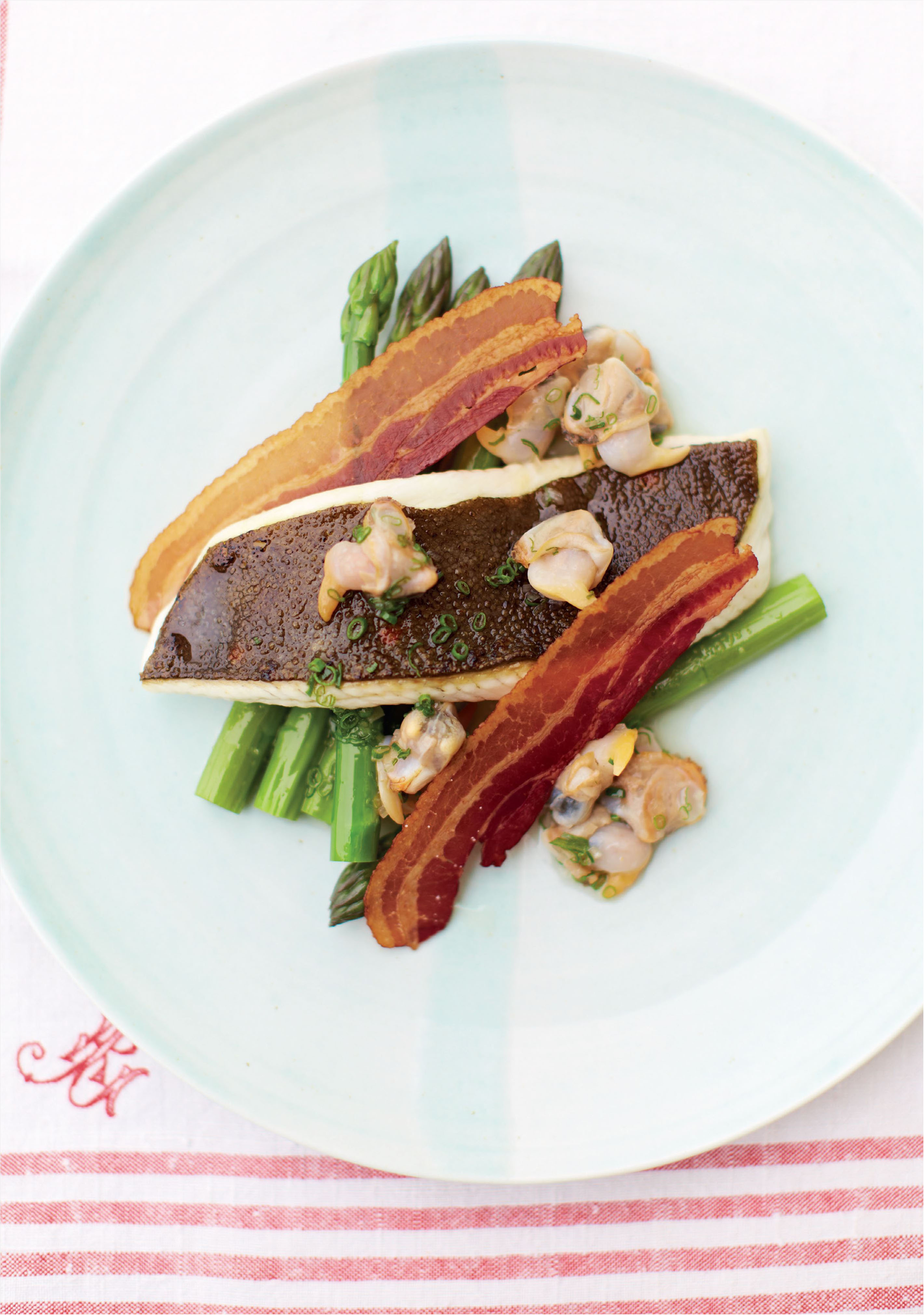 Grilled plaice, asparagus and pancetta with cockles