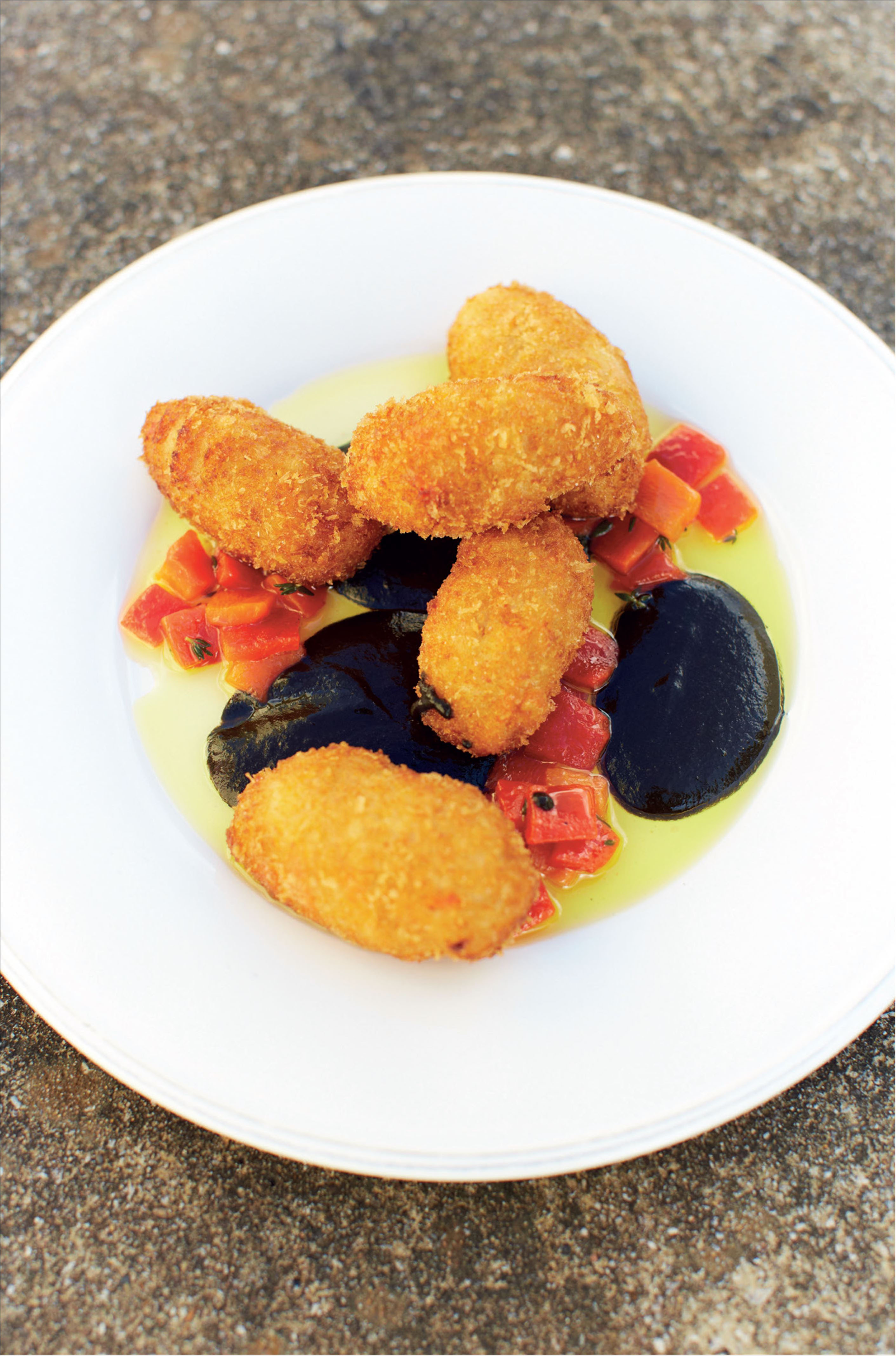 Cuttlefish fritters in a squid ink and red pepper sauce