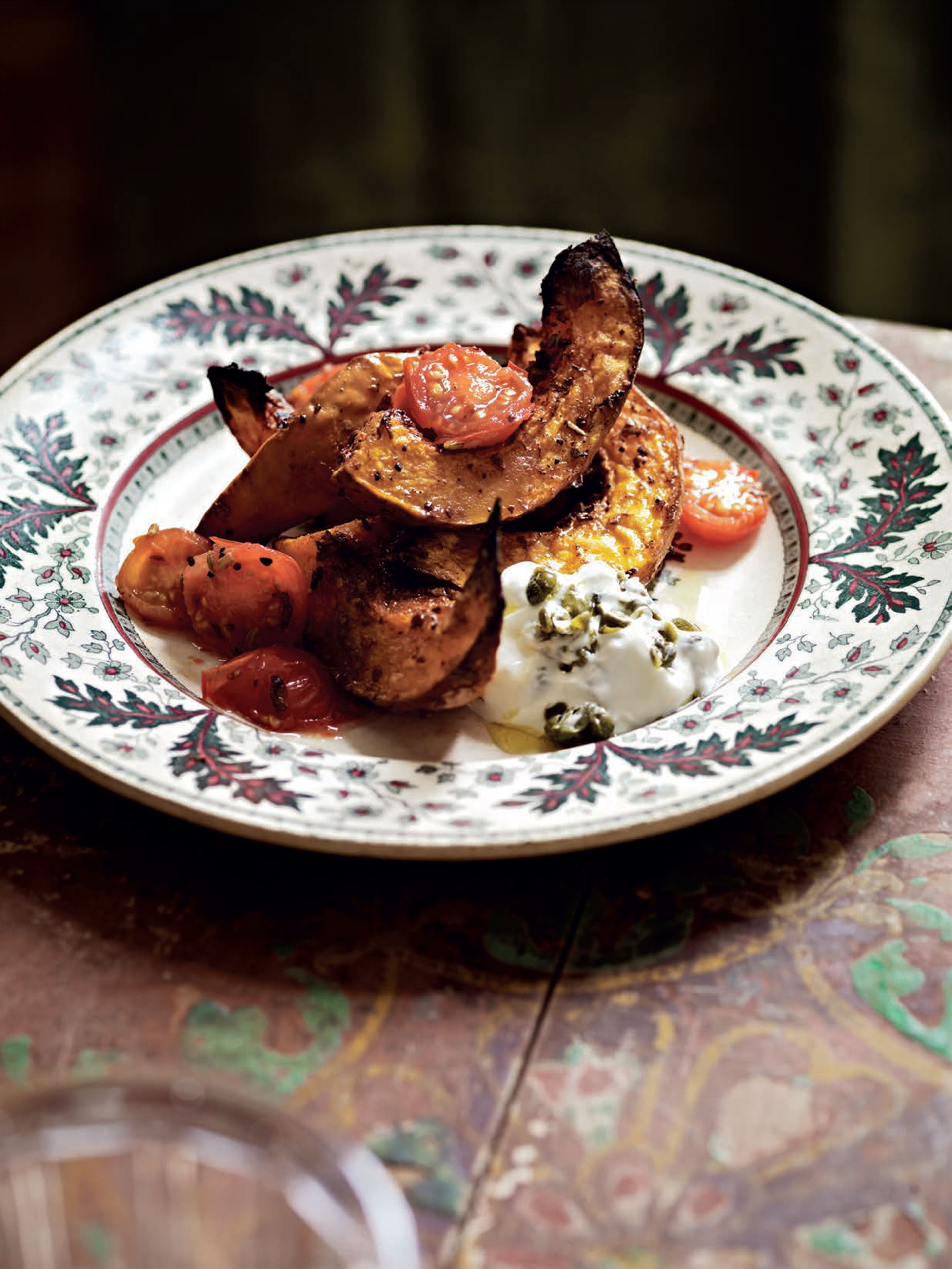 Spice-roasted butternut squash with tomatoes and capered yogurt