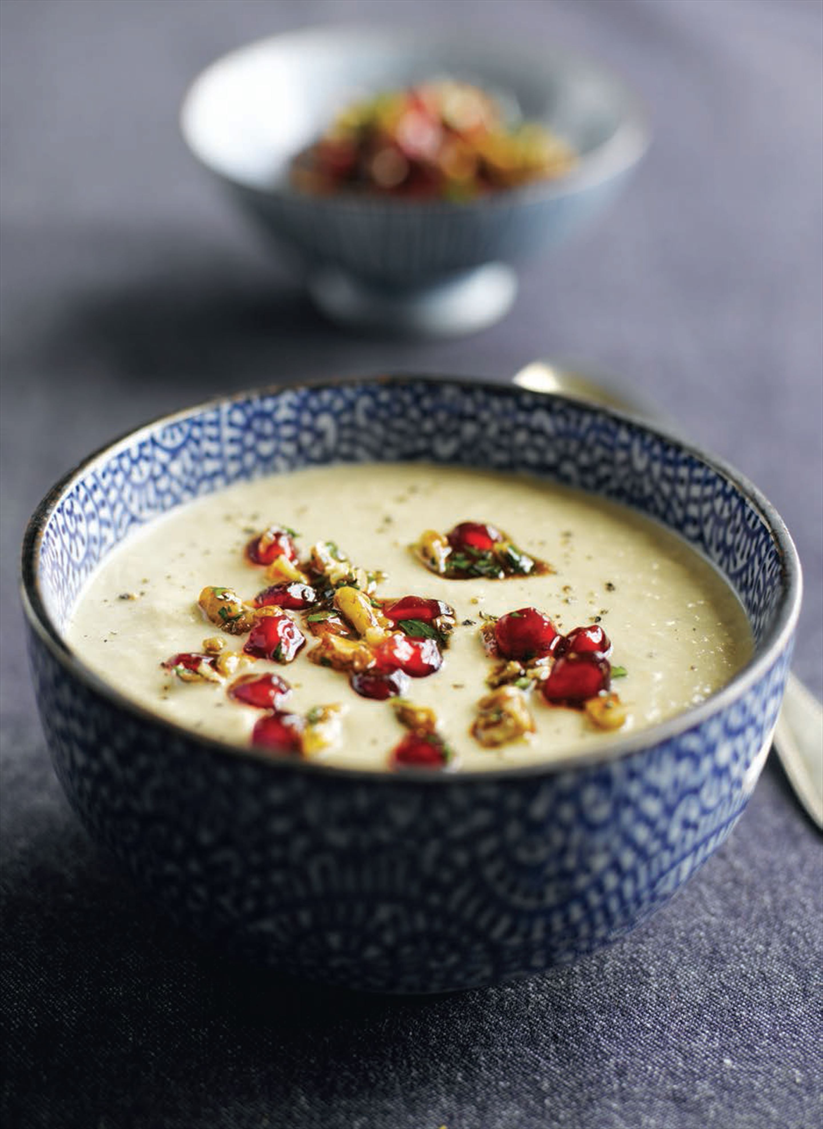 Creamy aubergine soup with walnut, parsley and pomegranate salsa