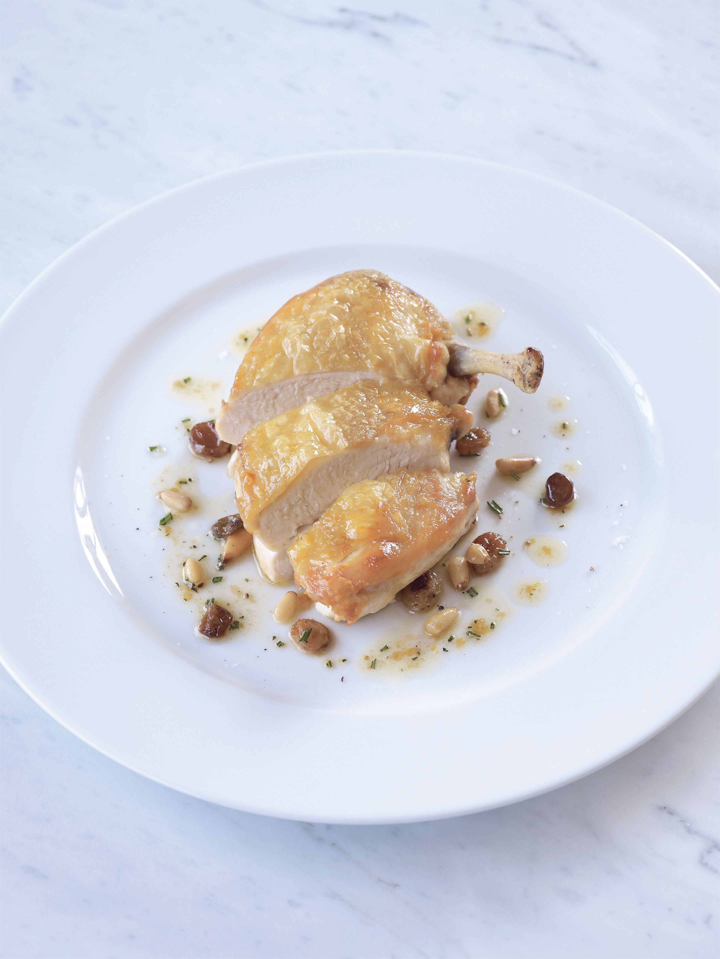 Chicken breasts with rosemary, lemon and pine nuts