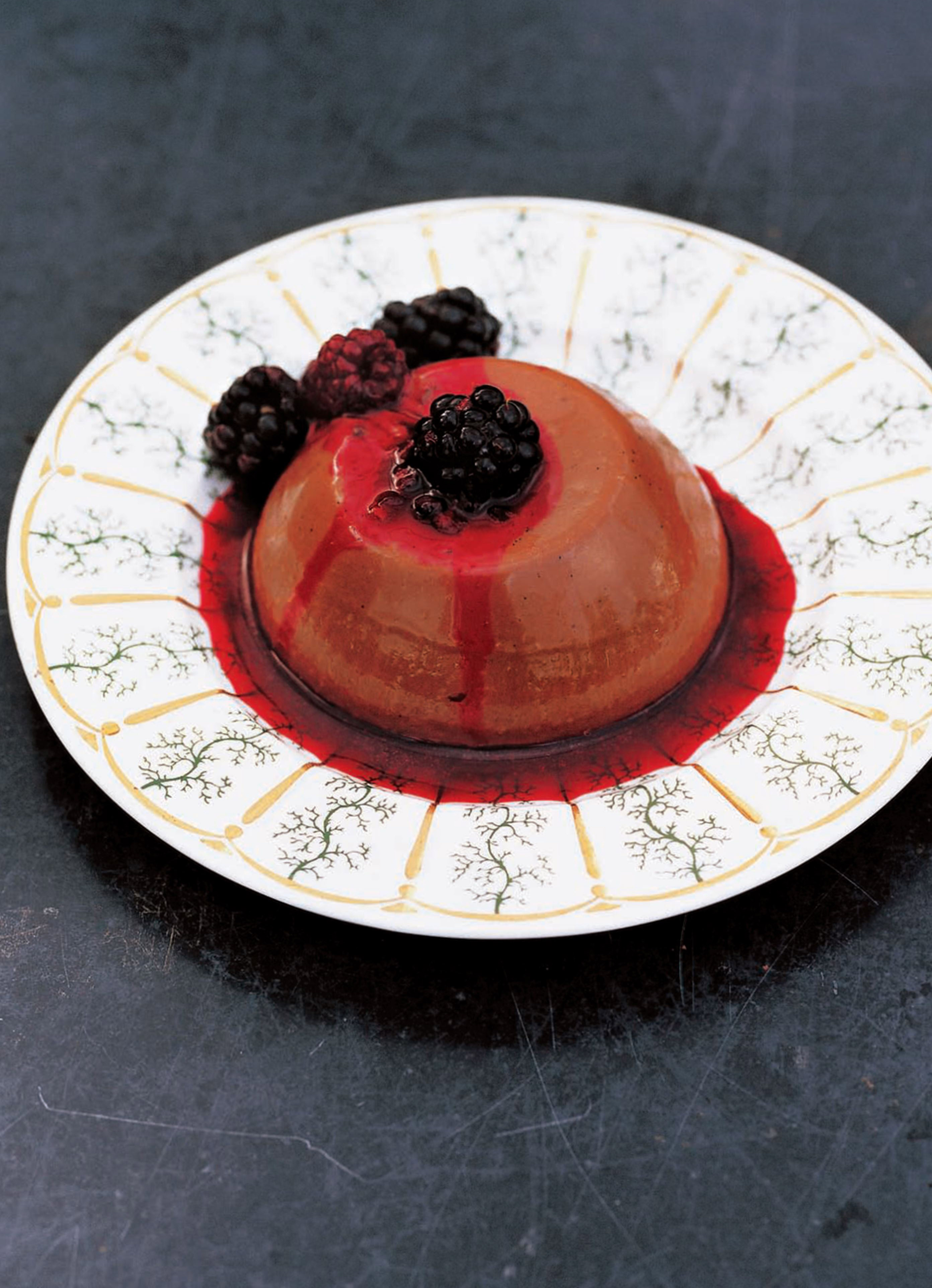Chocolate panna cotta with warm berries and honey