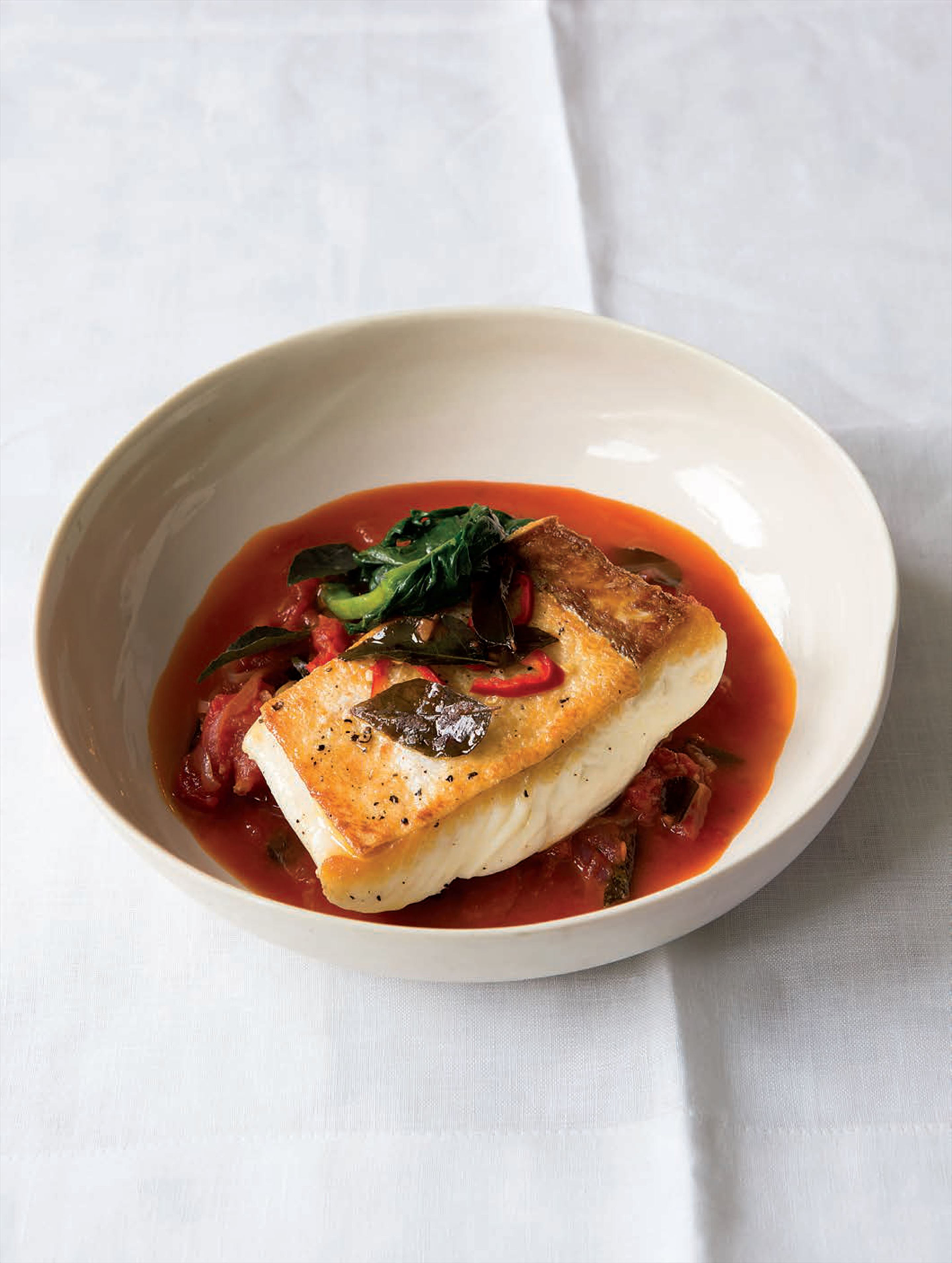 Halibut with mustard seeds, curry leaves and tomatoes