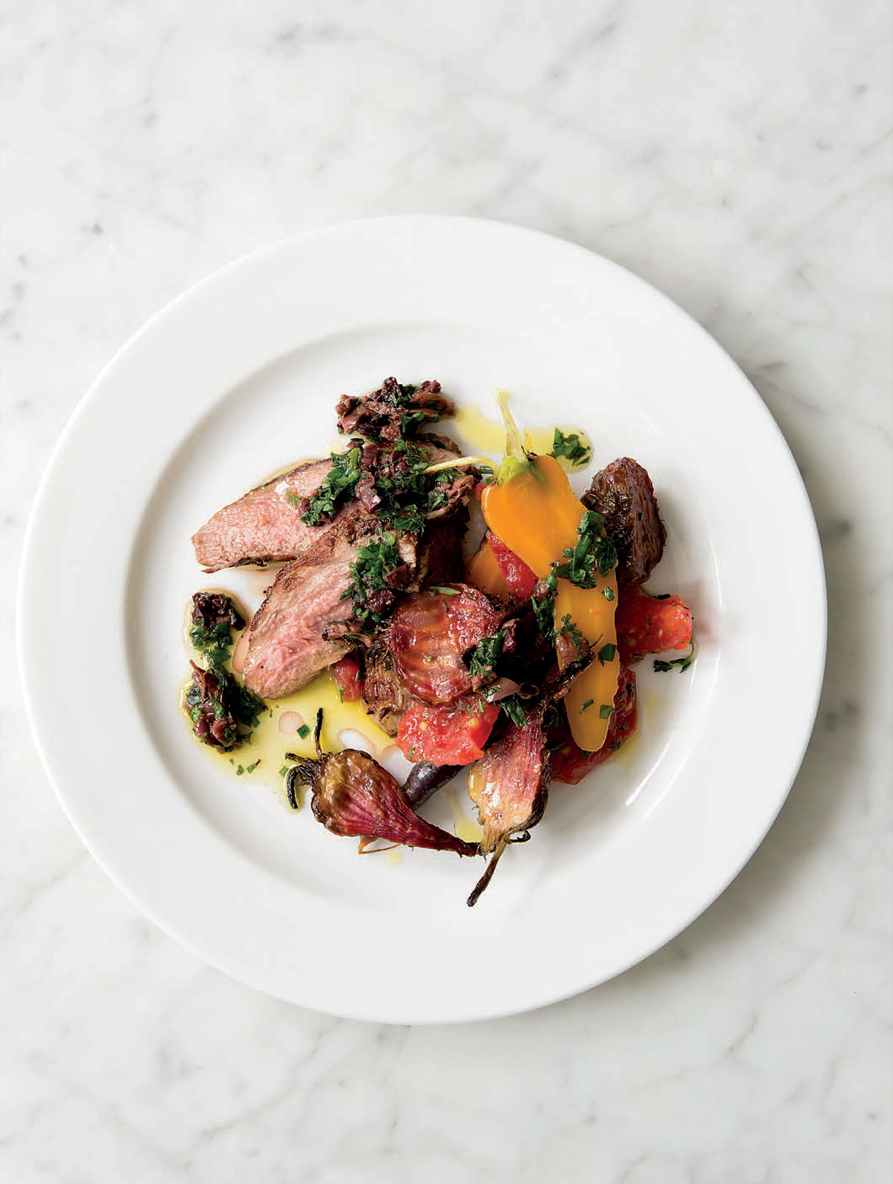 Butterflied lamb with roasted beetroots and carrots