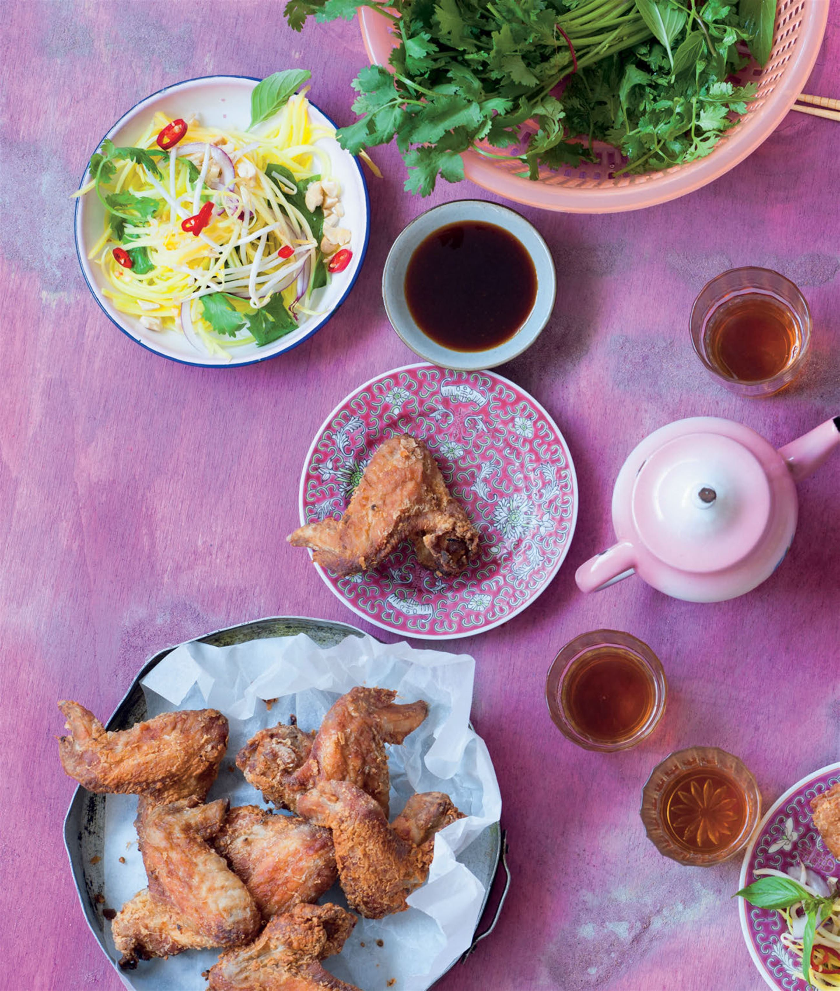 Chicken wings with green mango salad