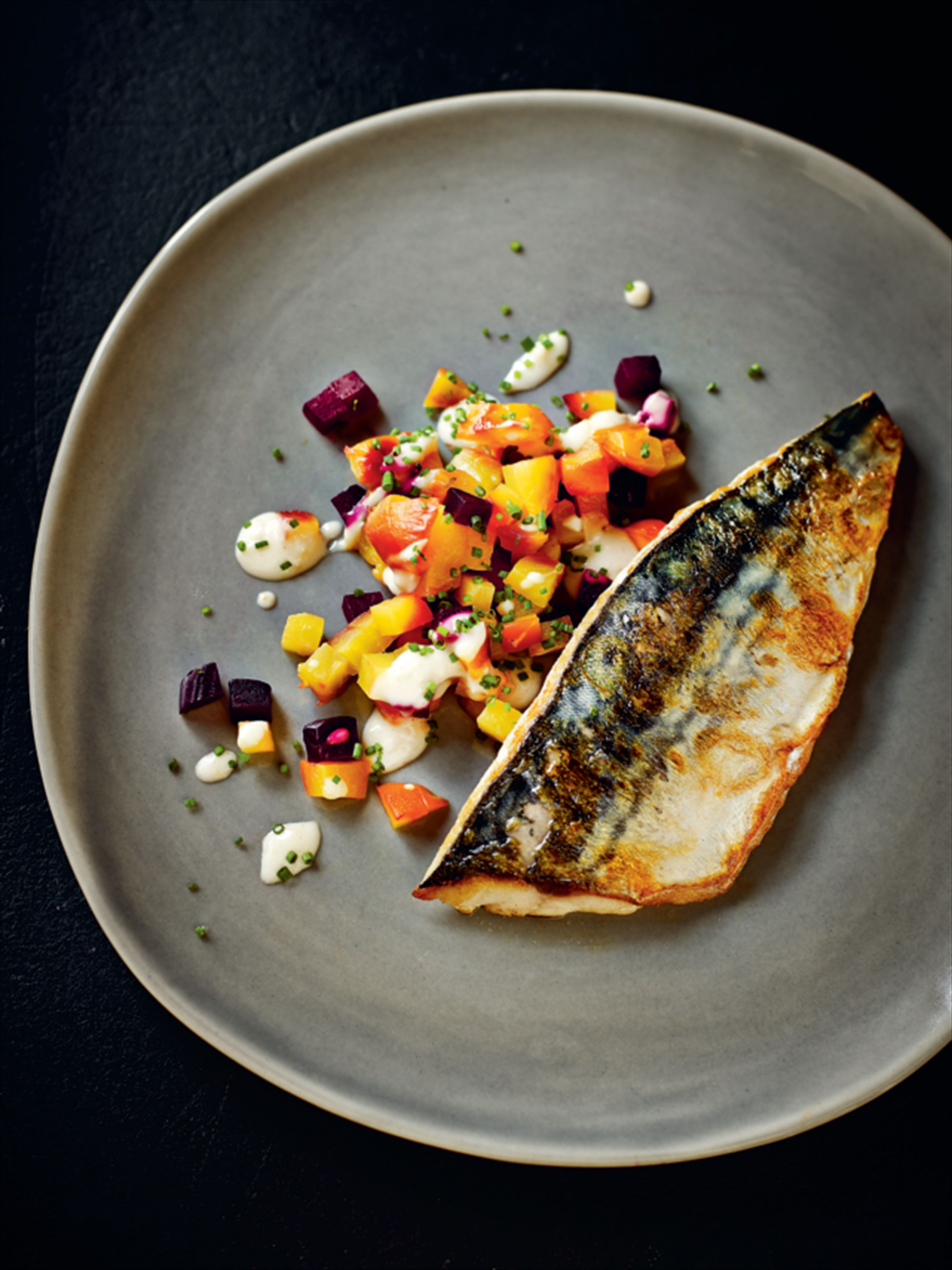Fried mackerel fillets on beetroot-horseradish crush