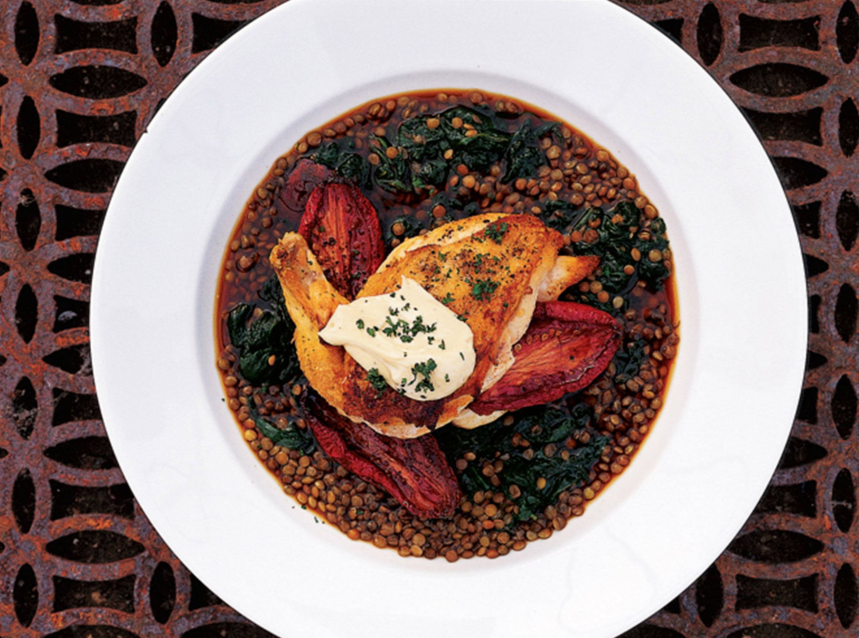 Pan-roasted chicken with lentils, roasted tomatoes and basil oil