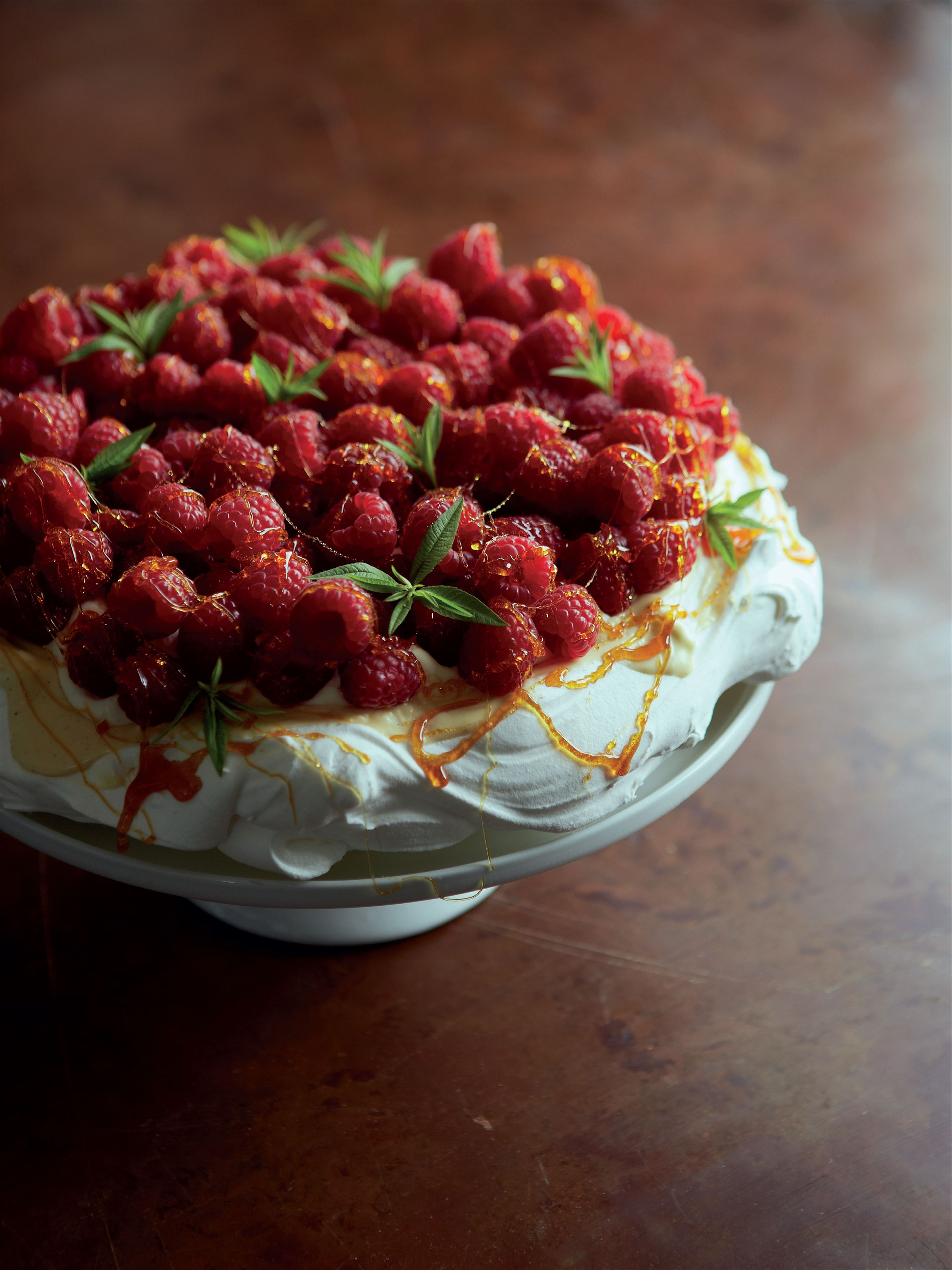 Raspberry, white chocolate and caramel pavlova
