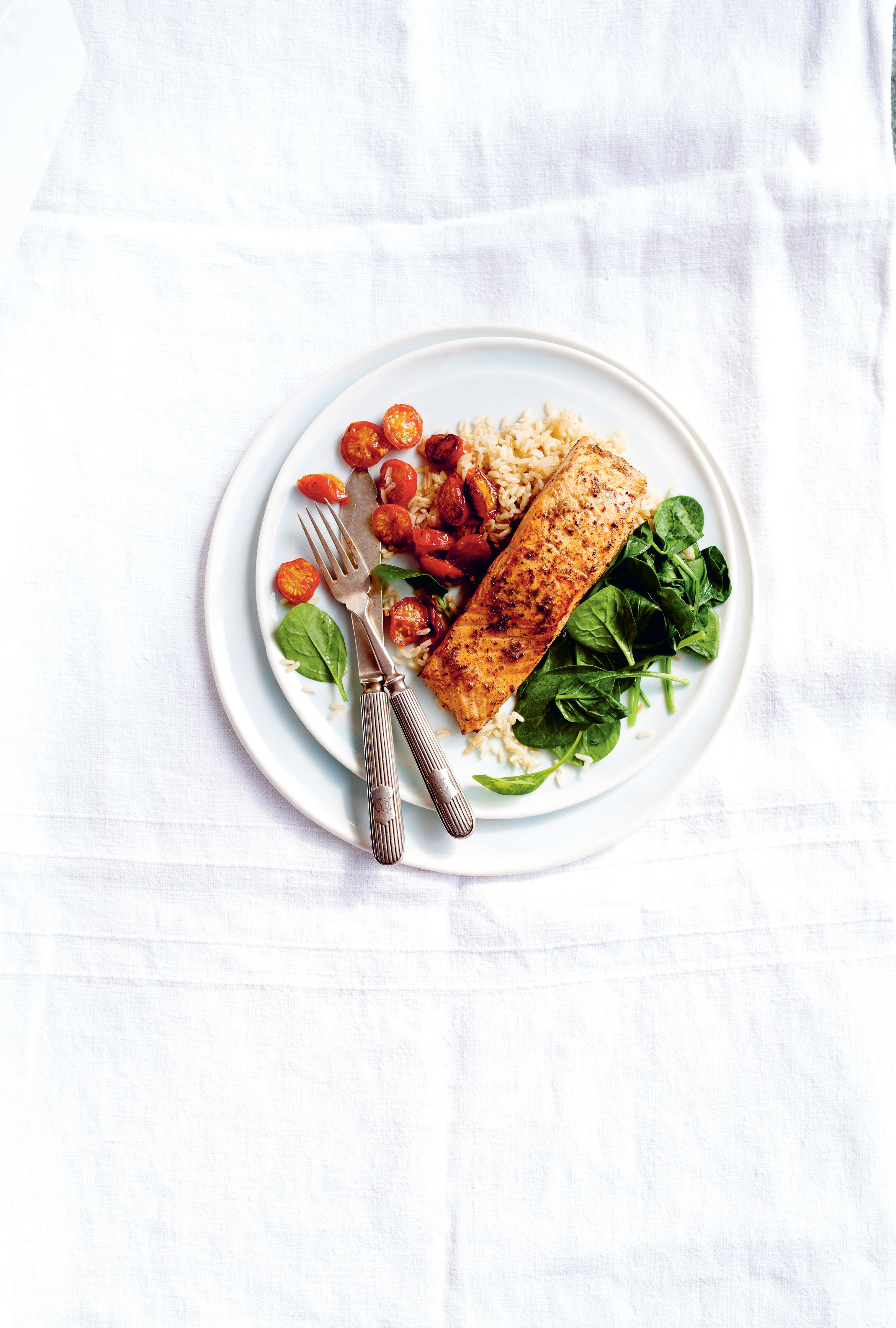 Pan-fried marinated salmon with wilted baby spinach