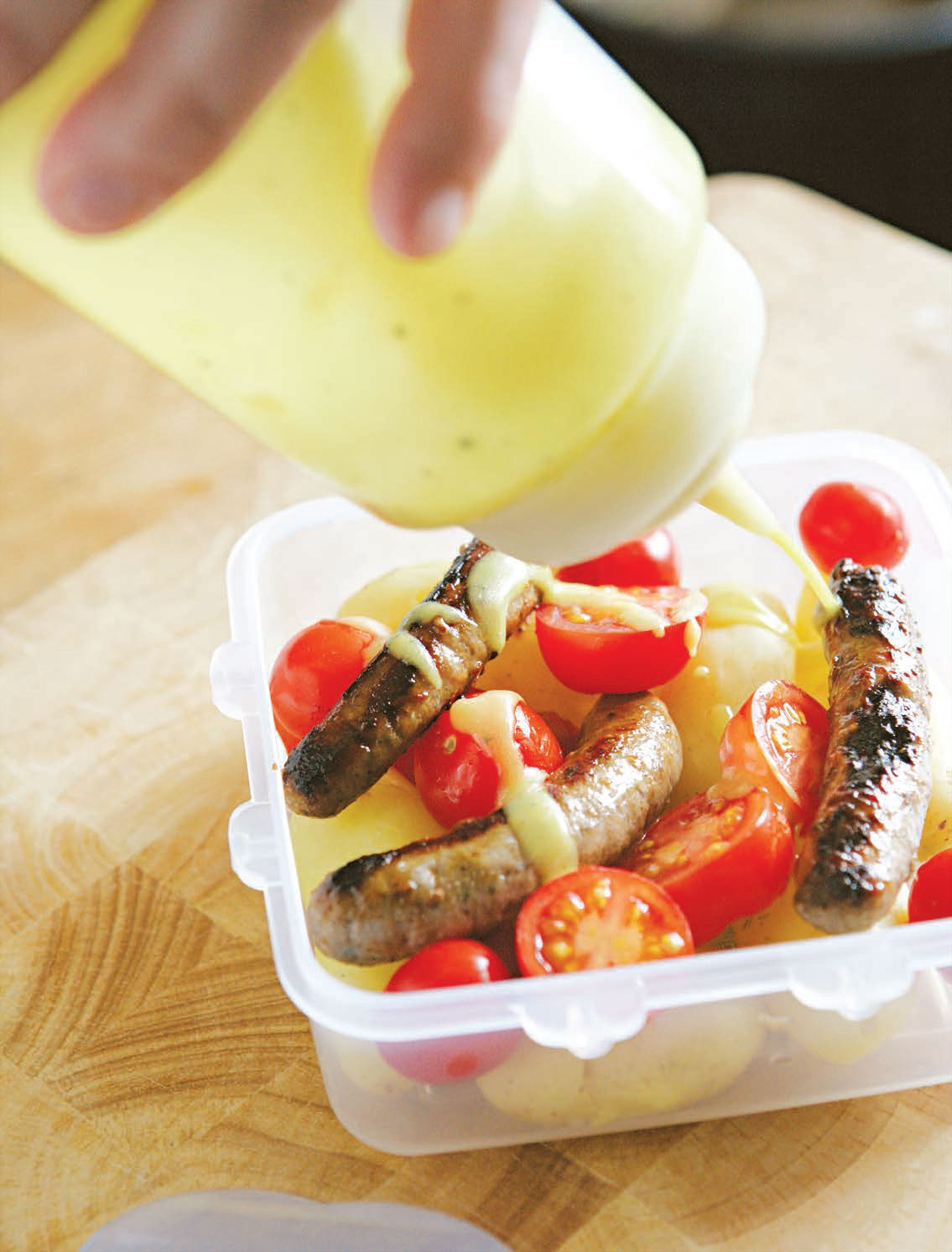 Tomato, chipolata and new potato lunch(box) with mustardy vinaigrette