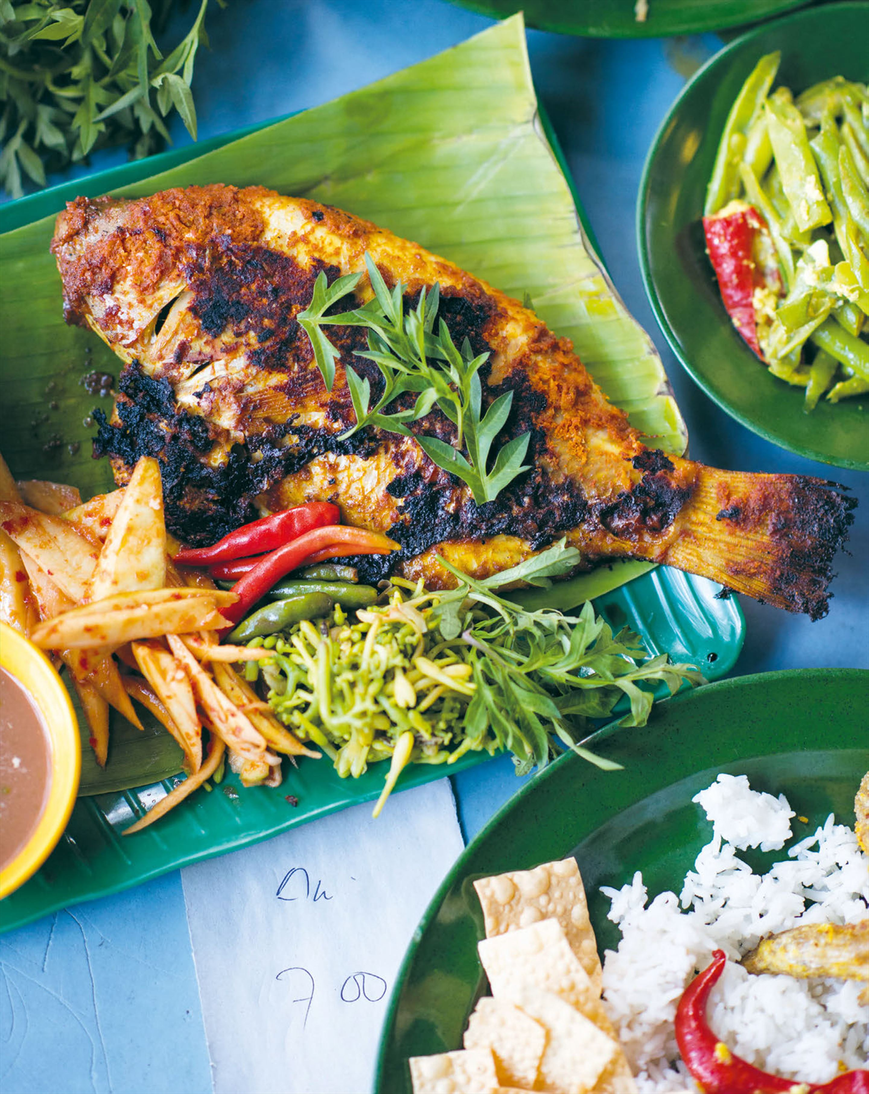 Grilled fish & herbs wrapped in banana leaf