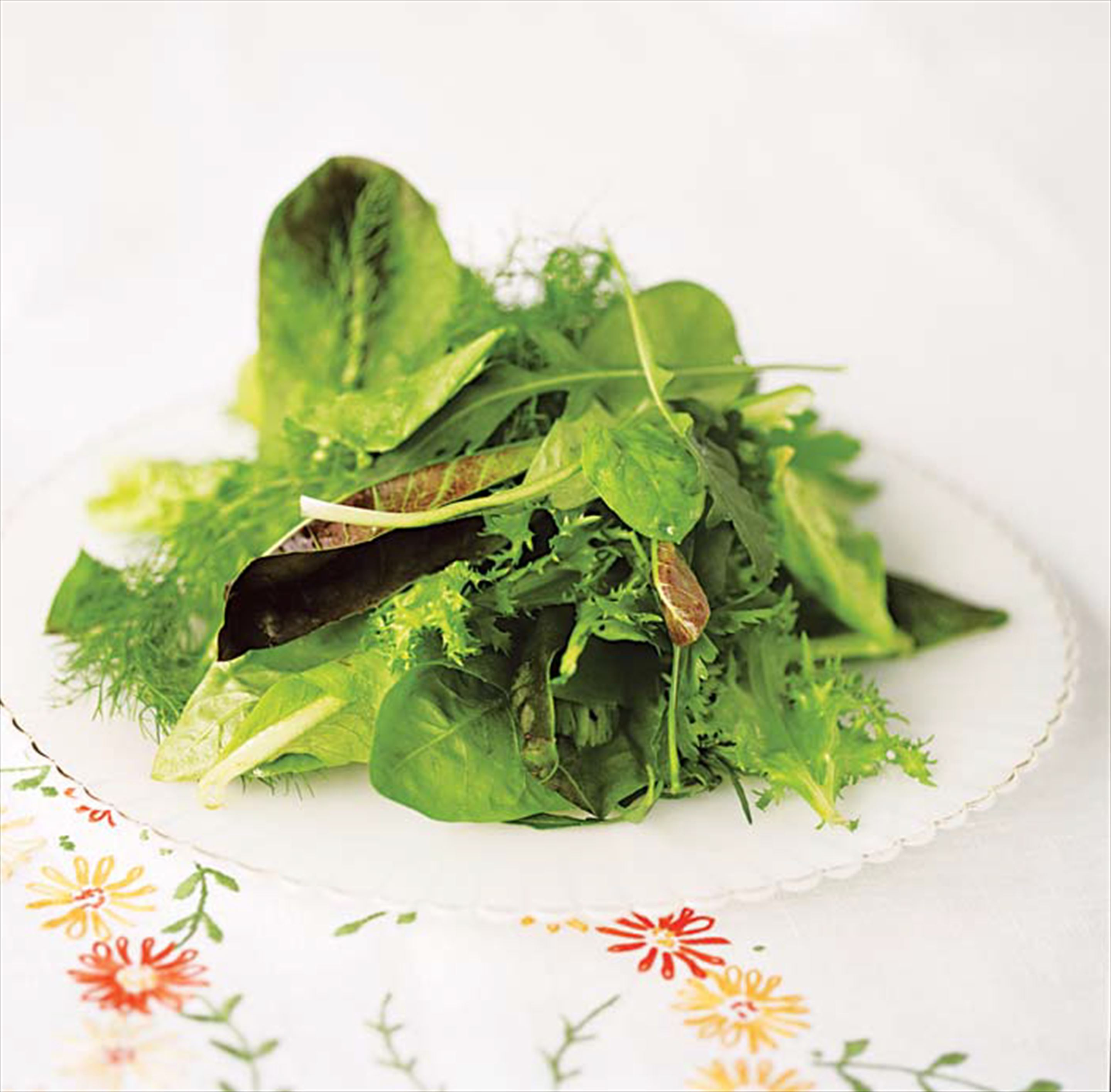 Leafy salad dressed with hazelnut vinaigrette