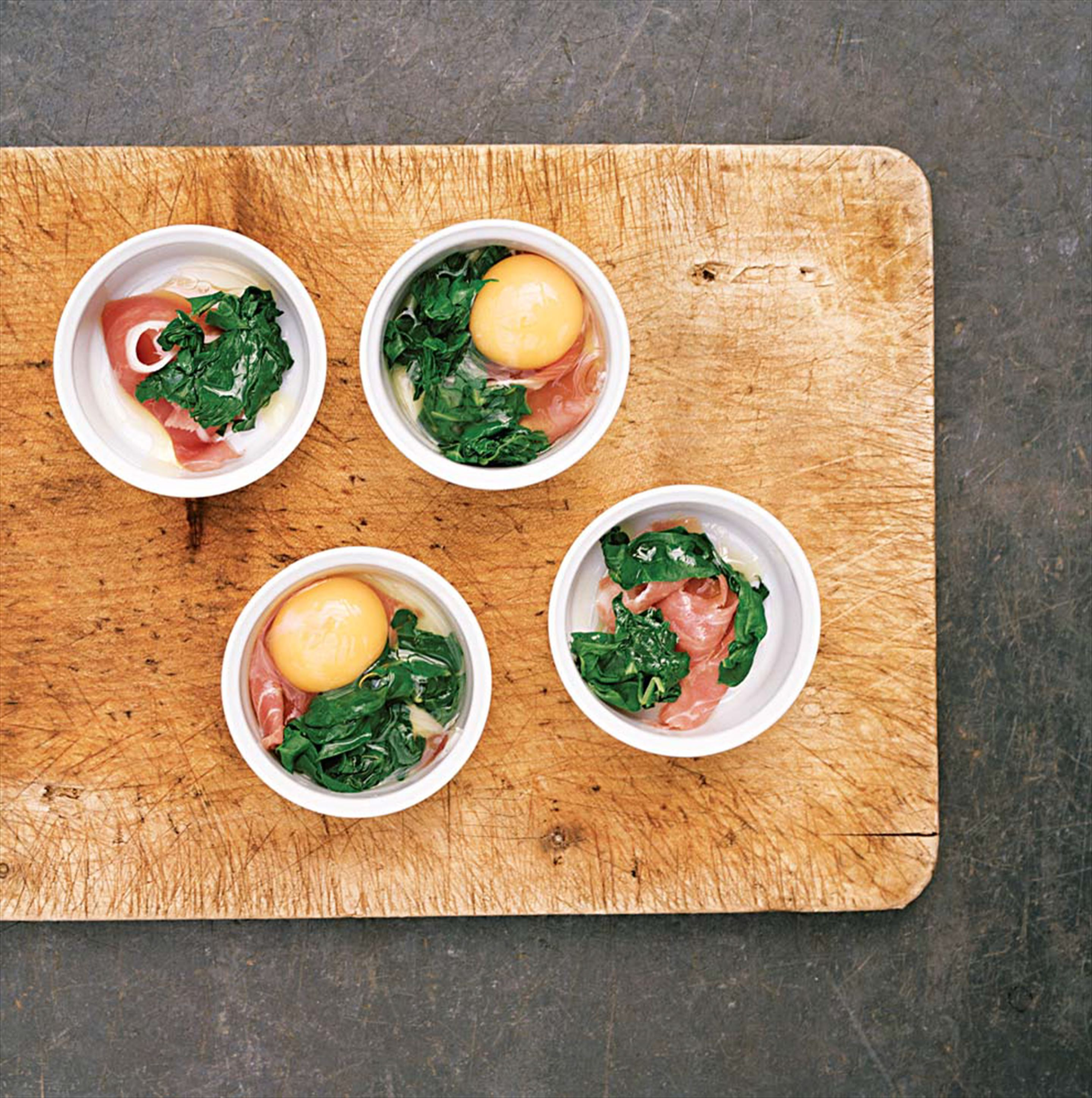 Oeufs en cocotte with spinach and parma ham