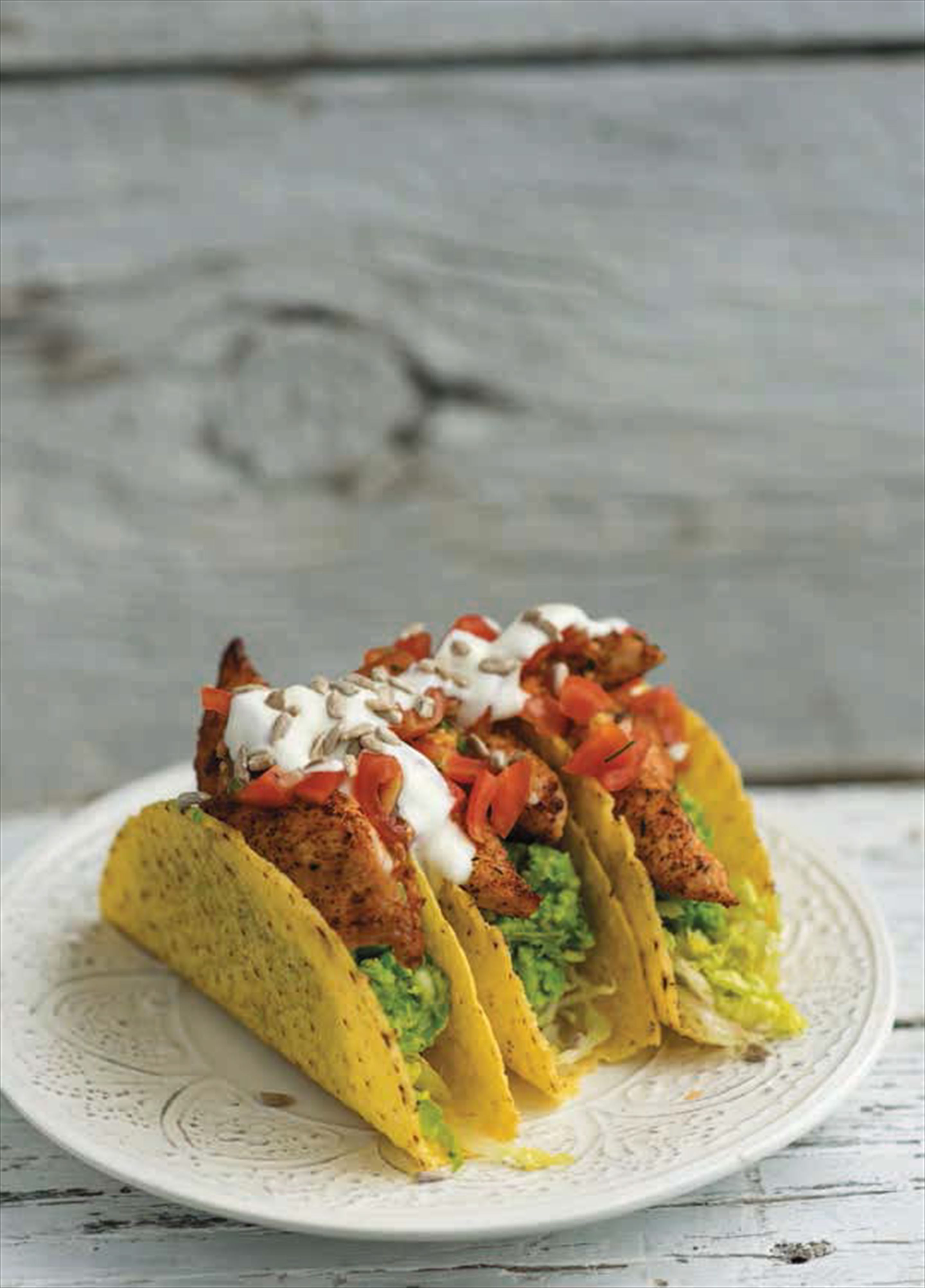 Blackened chicken tacos with avocado and pea guacamole