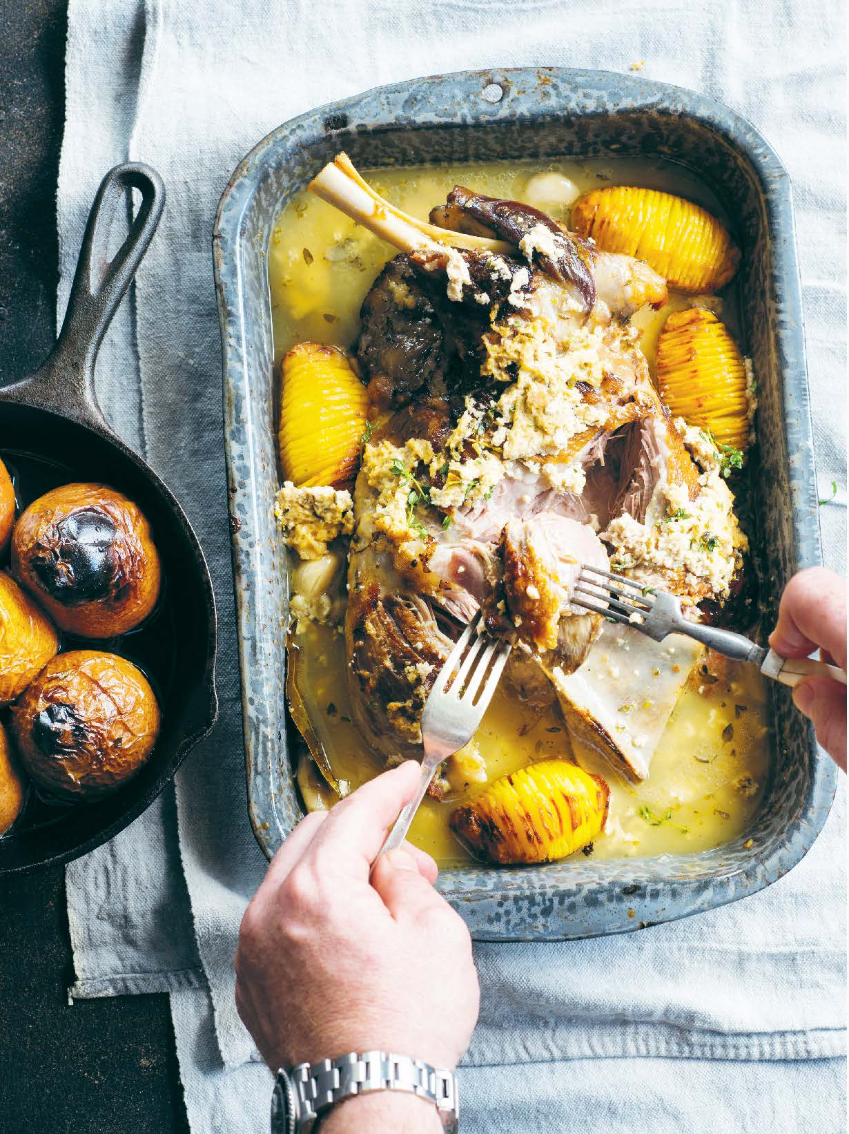 Pot-roasted shoulder of lamb cooked in buttermilk with roast pears and potatoes