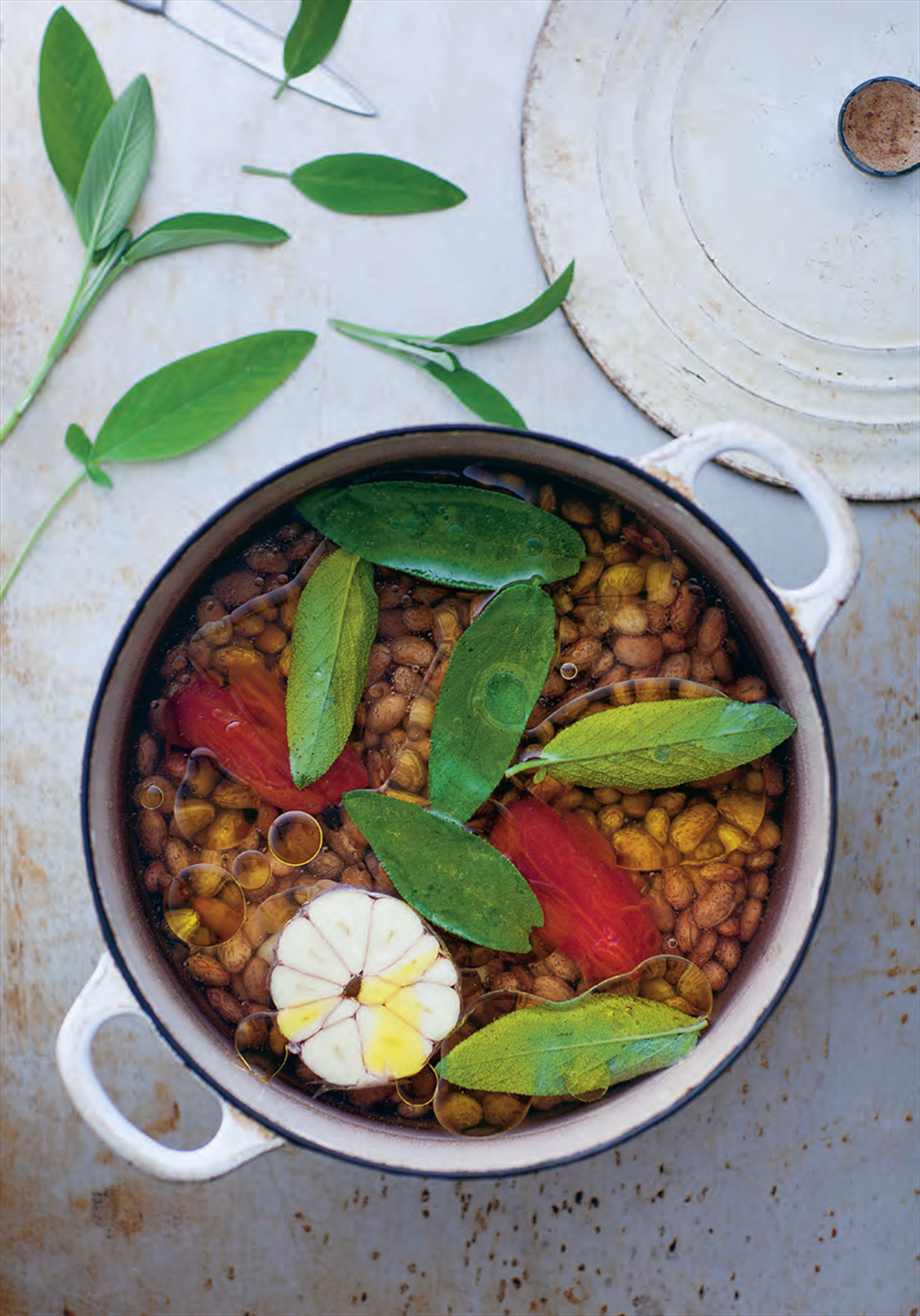 Dried beans cooked under oil and water with sage