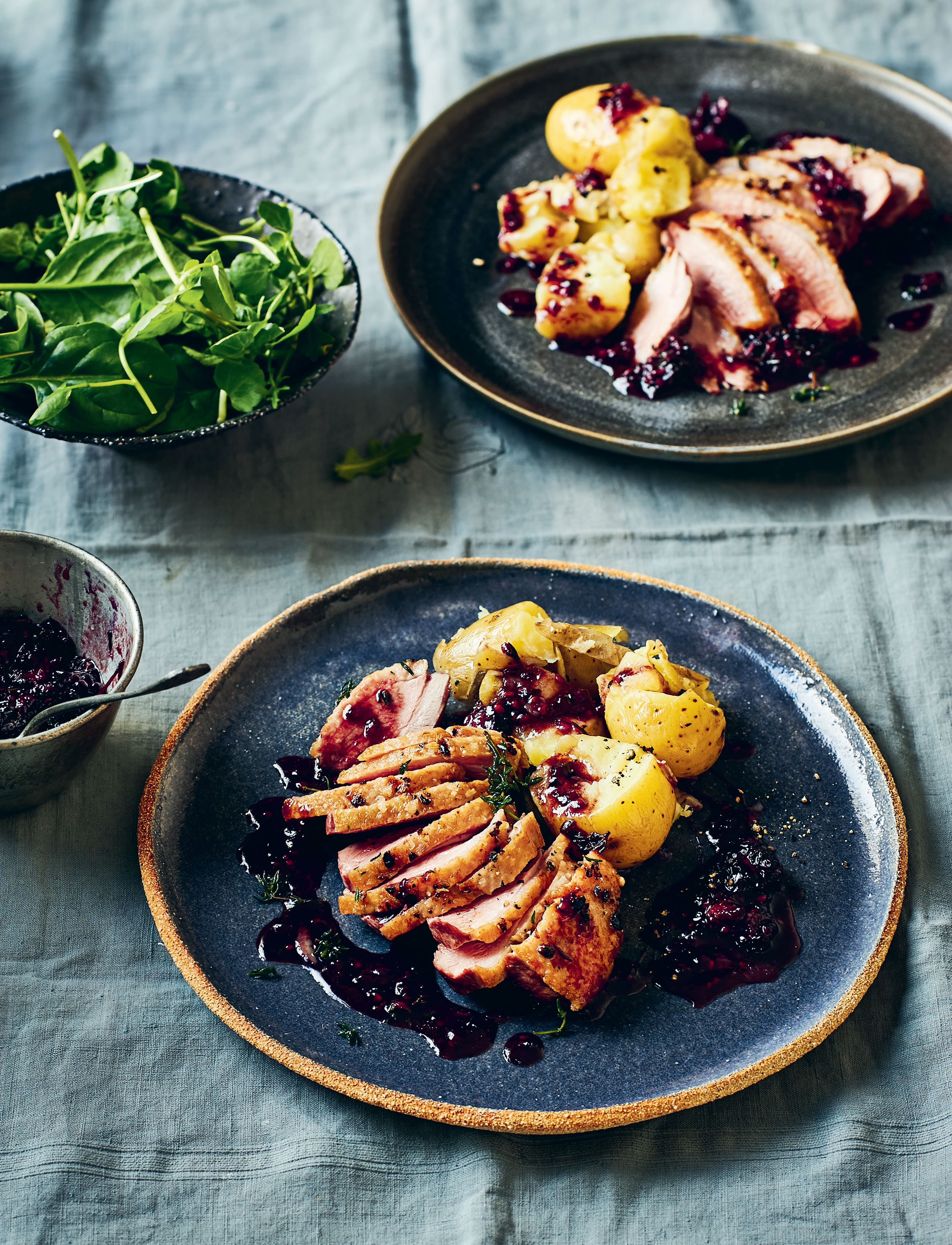 Duck breasts with juniper, blackberry and port sauce