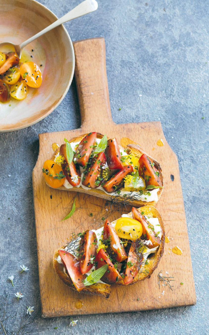 Heirloom tomatoes on sourdough with stracciatella and lemon verbena