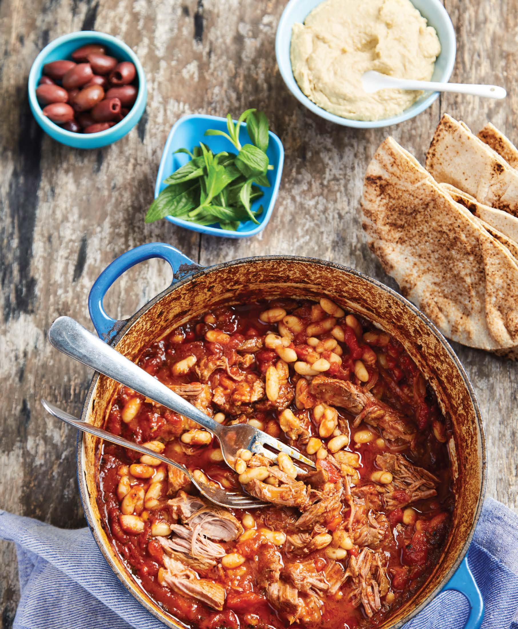 Slow-cooked lamb shoulder with cannellini beans and hummus