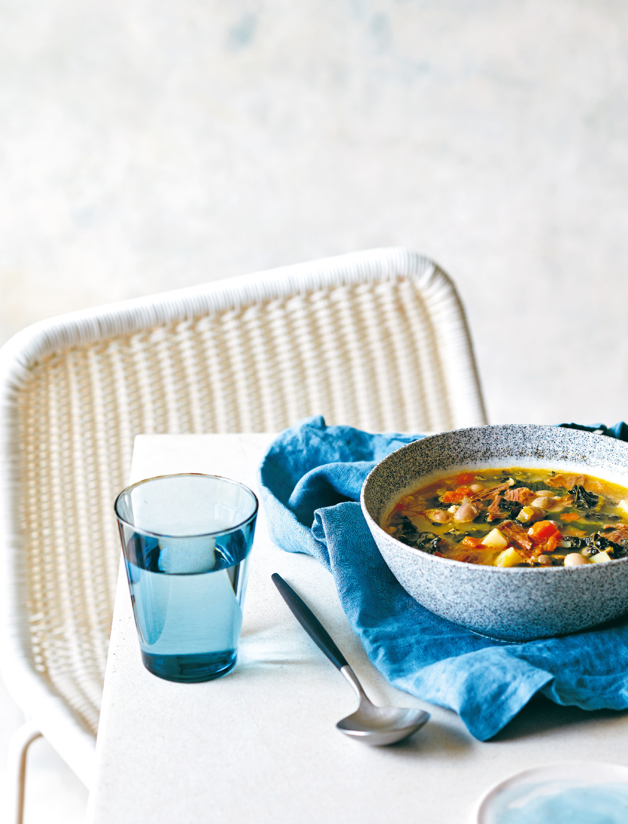 Borlotti bean and vegetable soup with slow-cooked lamb shoulder and parsley oil