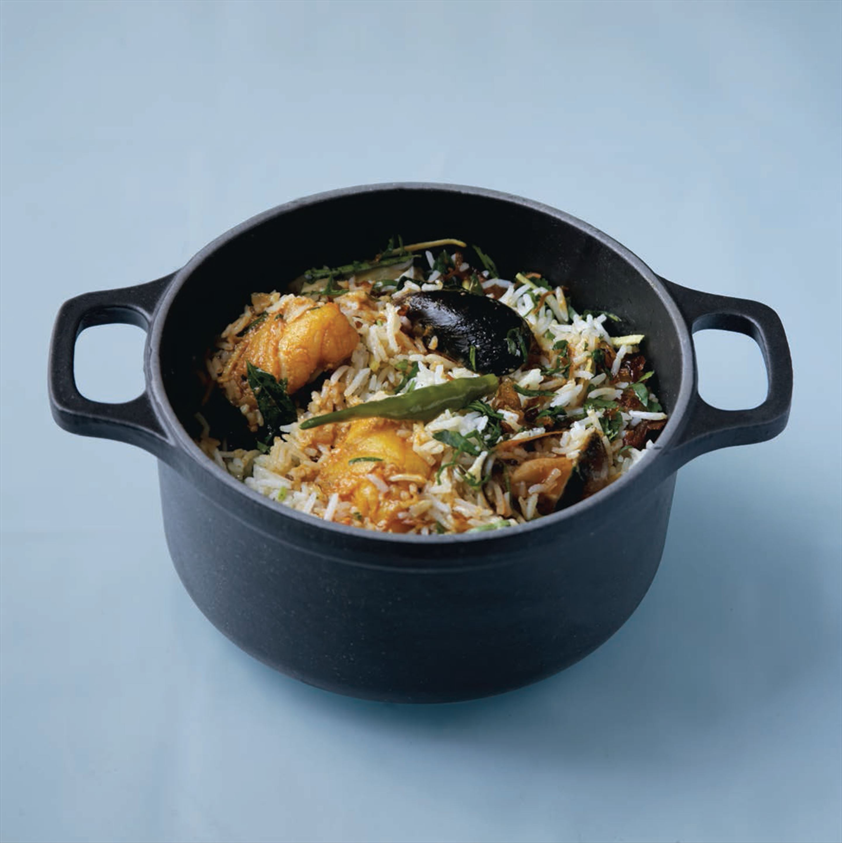 Kerala-style biryani with mussels and monkfish