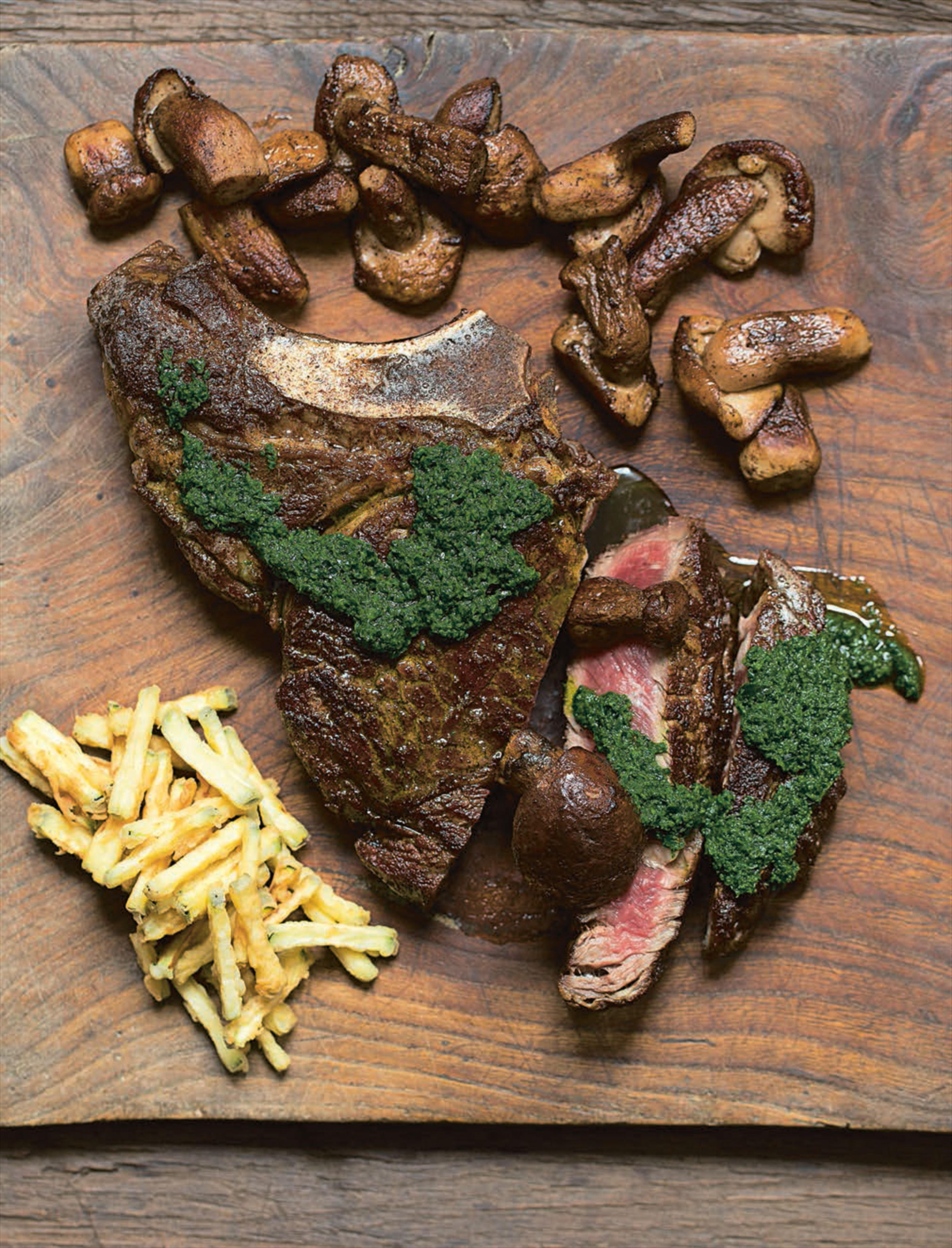 Côte de boeuf with herb salsa, courgette frites and ceps
