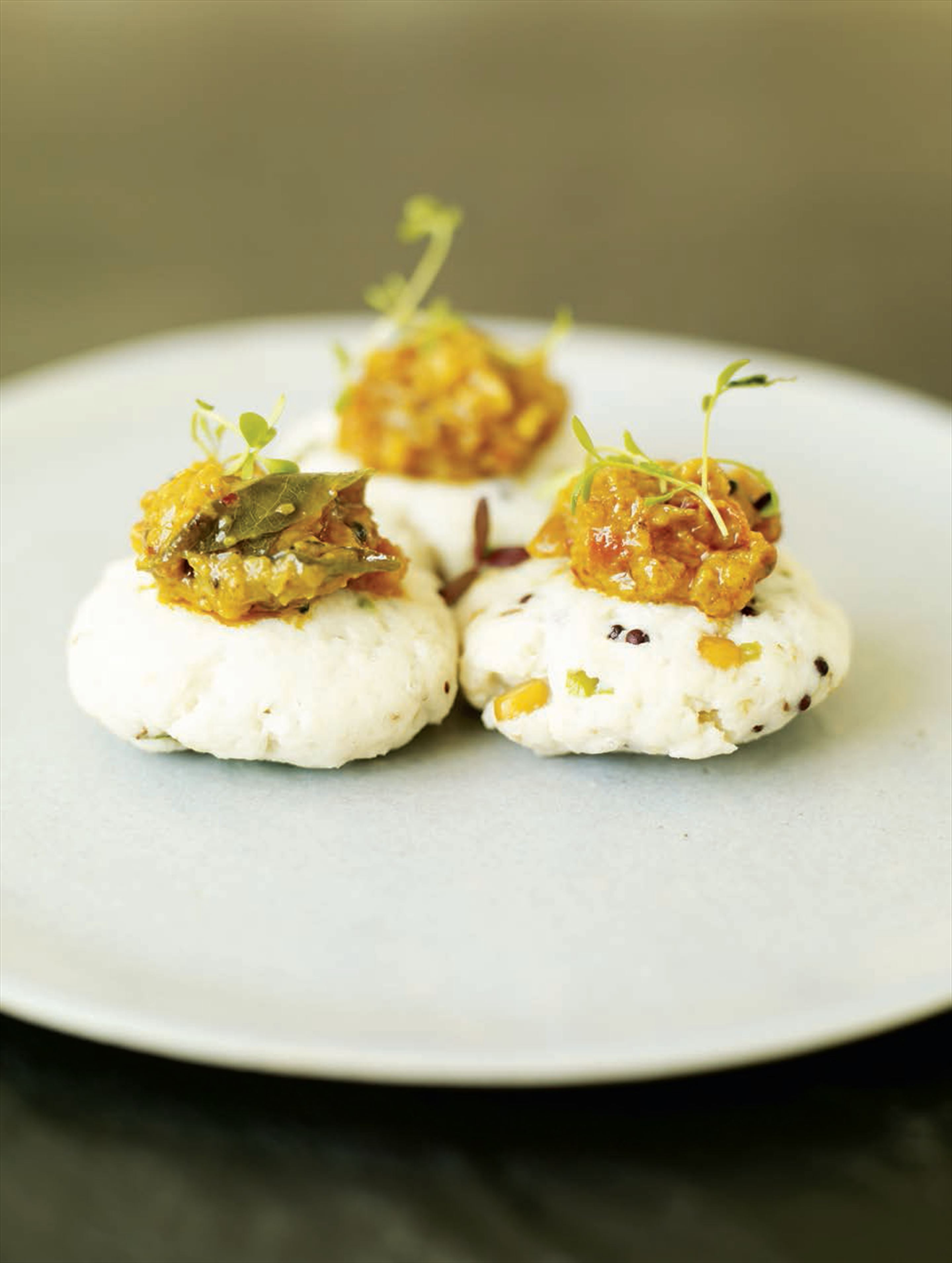 Steamed pollack cakes with tomato, coriander and peanut chutney