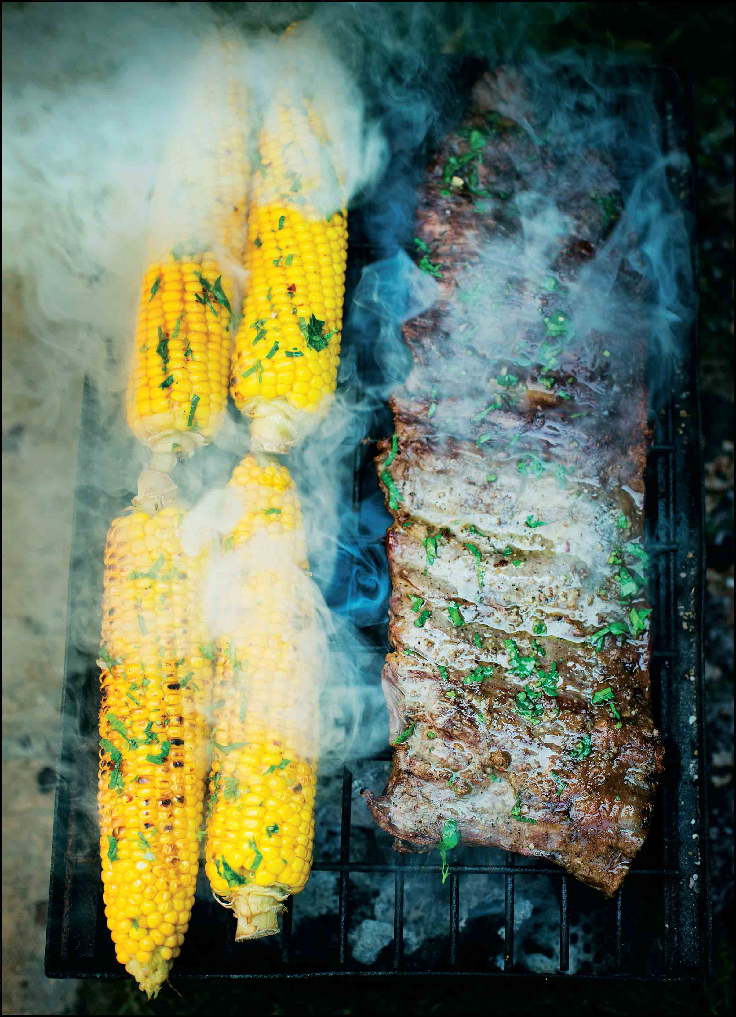 Corn on the cob with bavette steak and chimichurri
