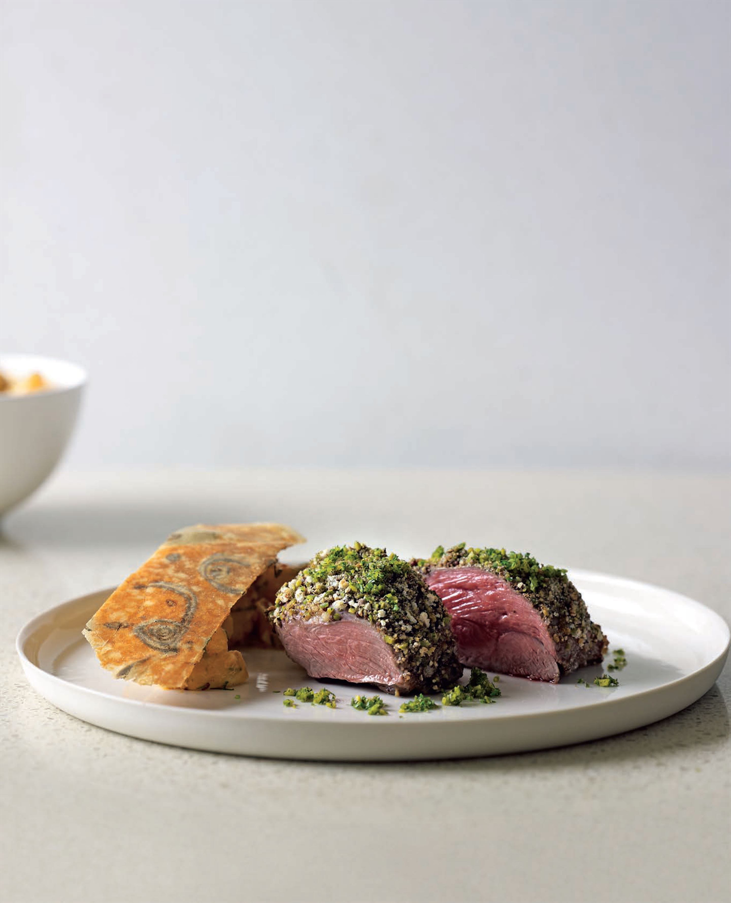 Lamb rump with pistachios and peppercorns