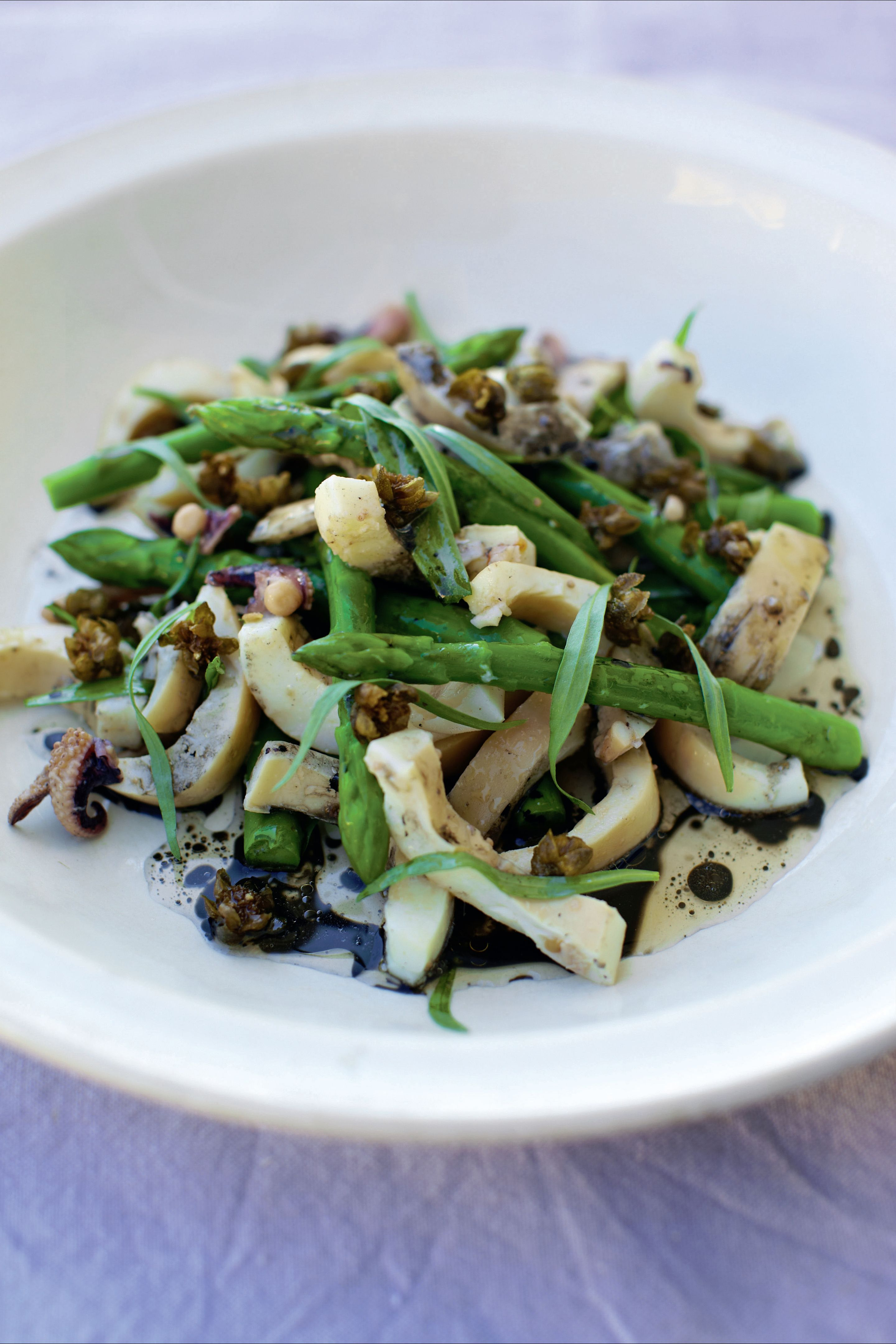 Warm salad of cuttlefish and asparagus with cuttlefish ink dressing