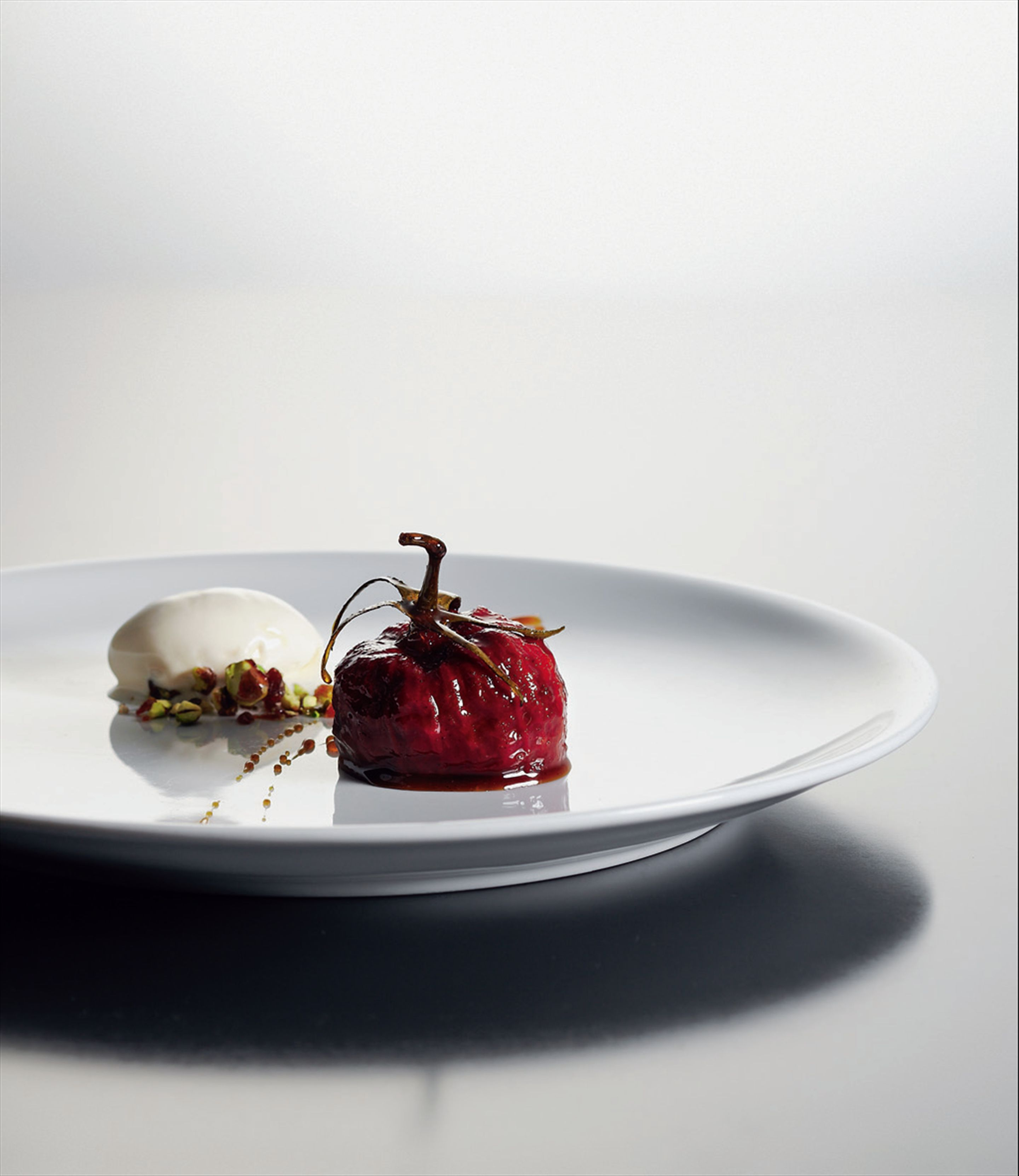 Caramelised tomato stuffed with twelve flavours and star anise ice cream