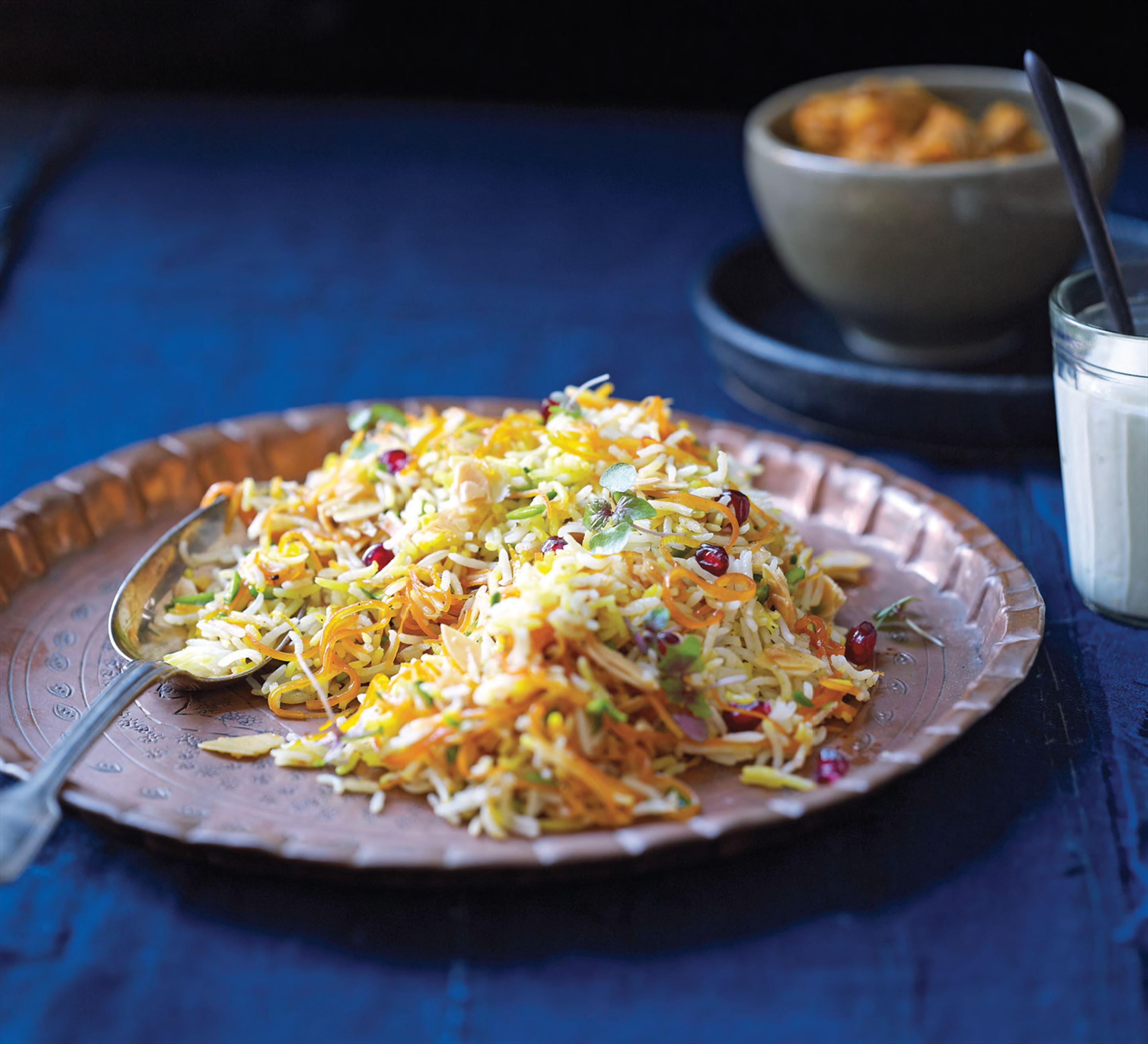 Sweet rice with saffron, nuts and orange zest