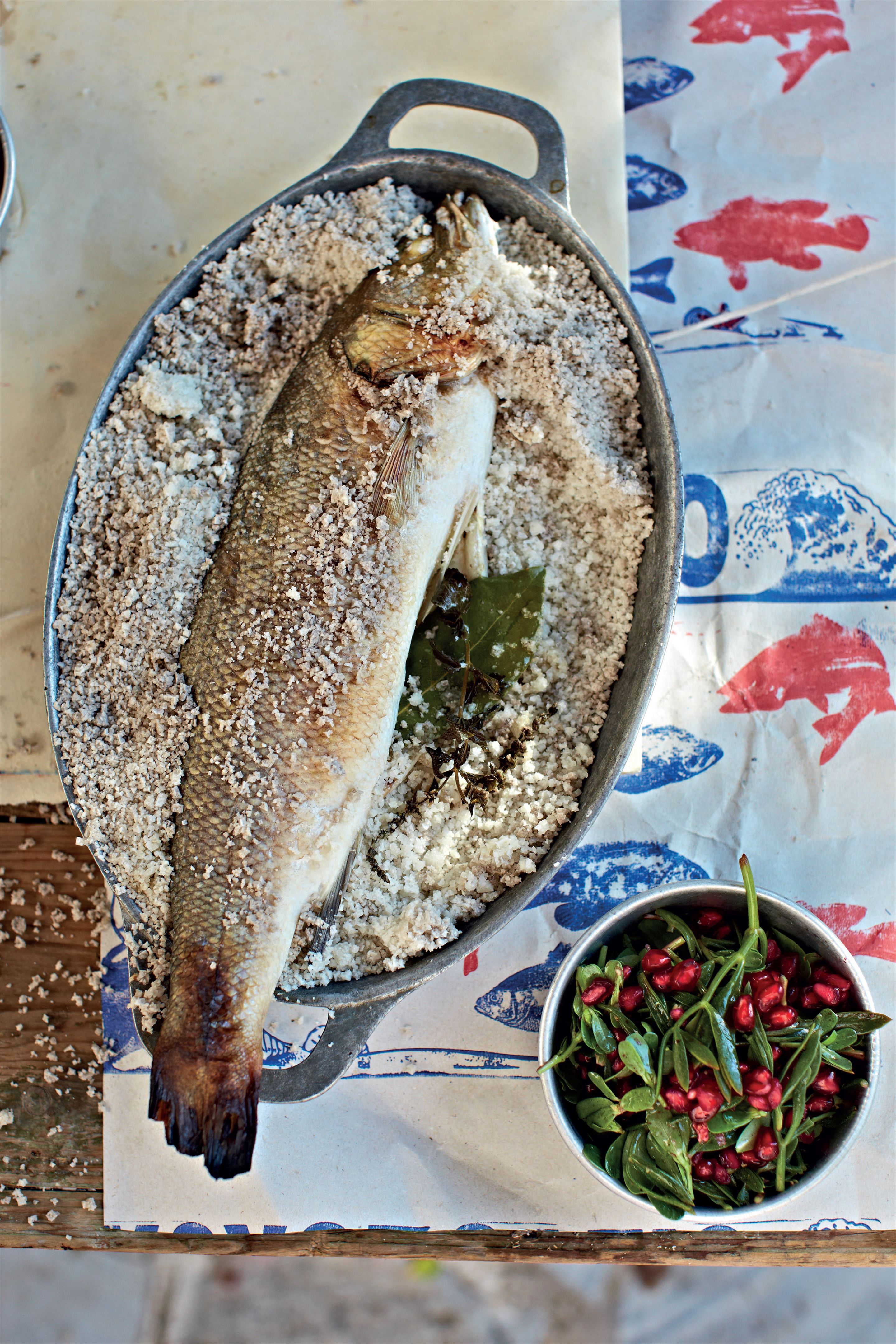 Salt-baked sea bass with samphire and pomegranate salad
