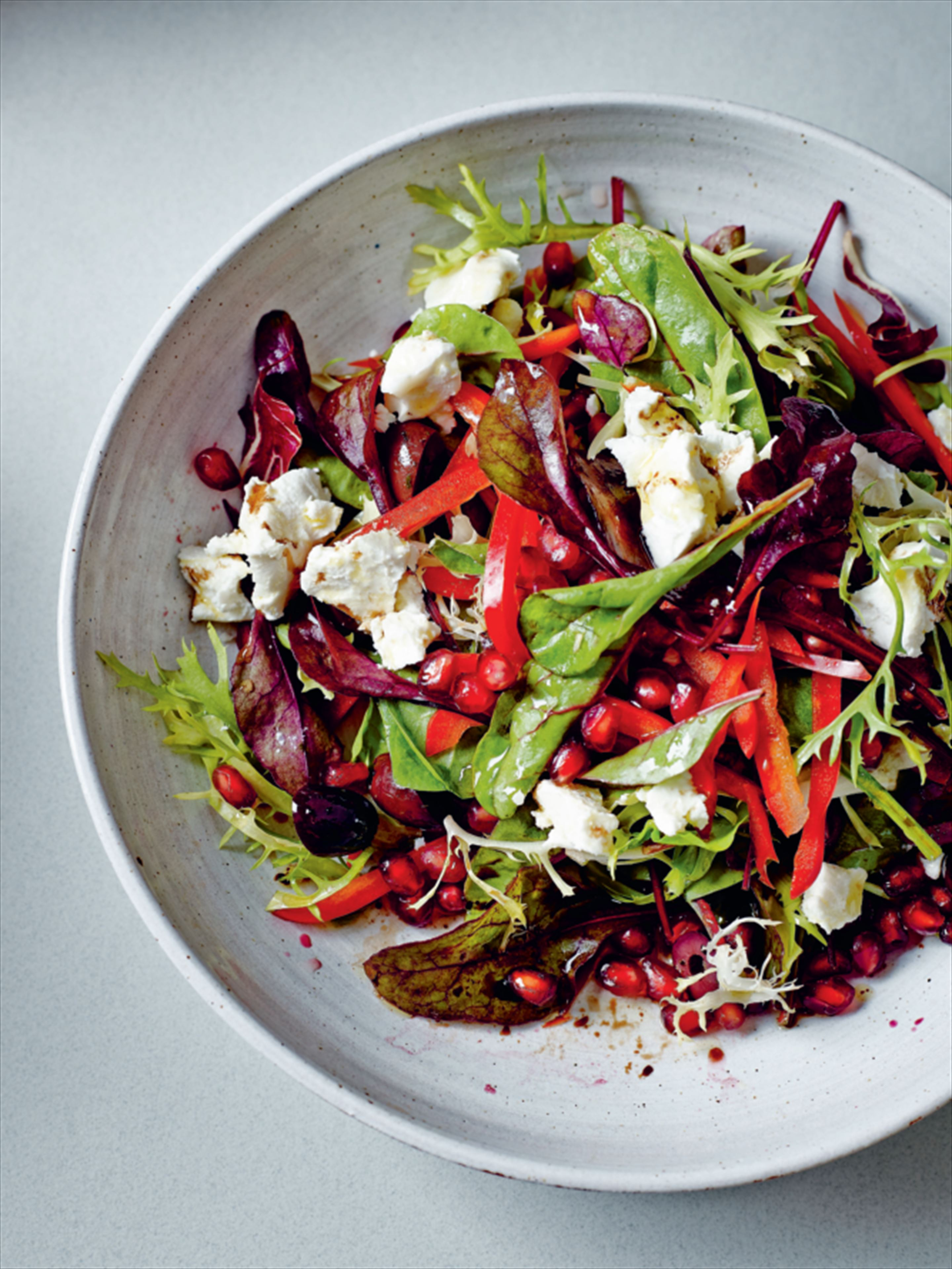 Goat's cheese, pomegranate and olive salad