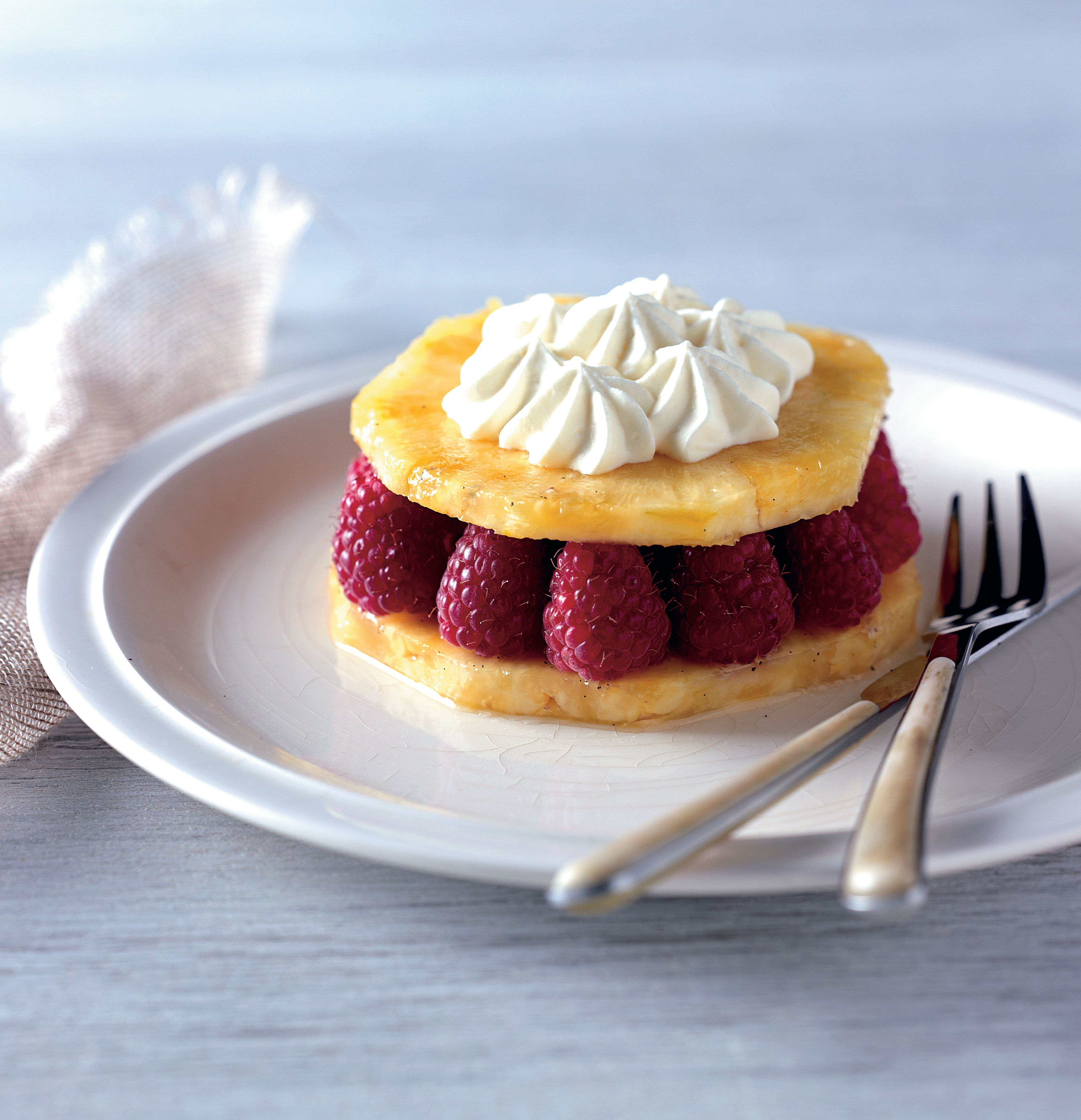 Pineapple and raspberries with crème fraîche chantilly