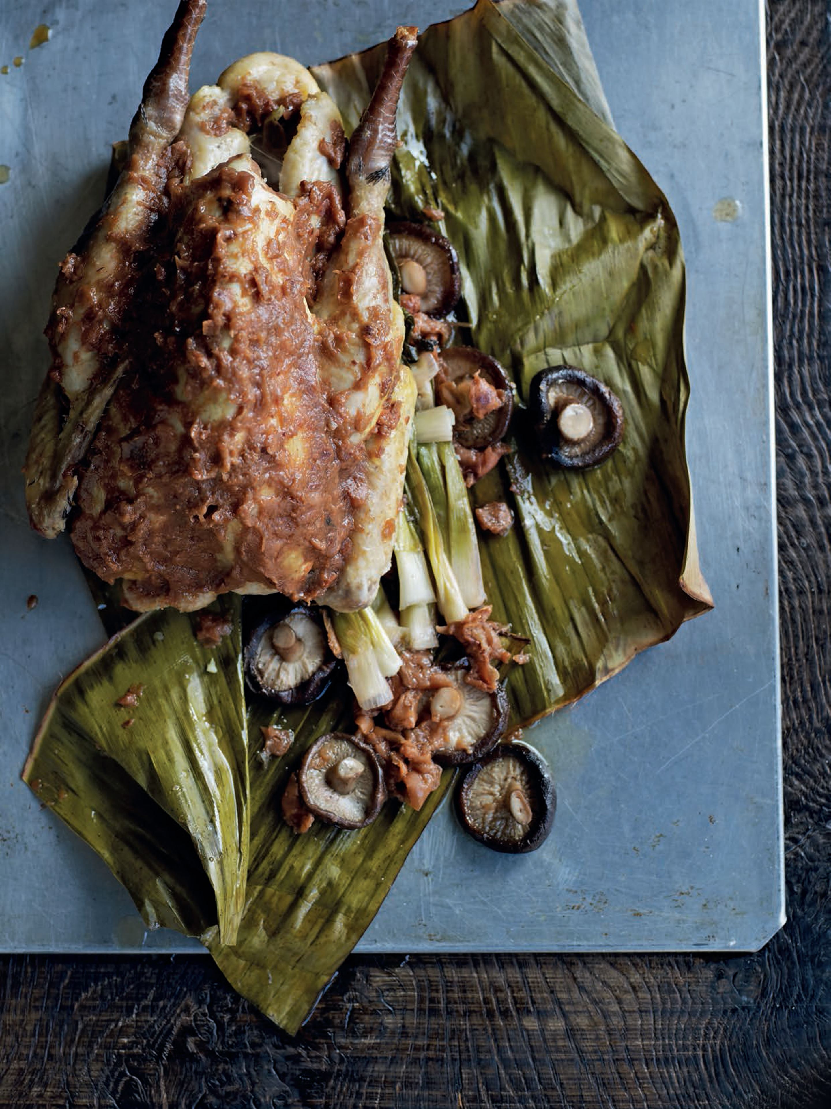 Guinea fowl with umeboshi in banana leaf