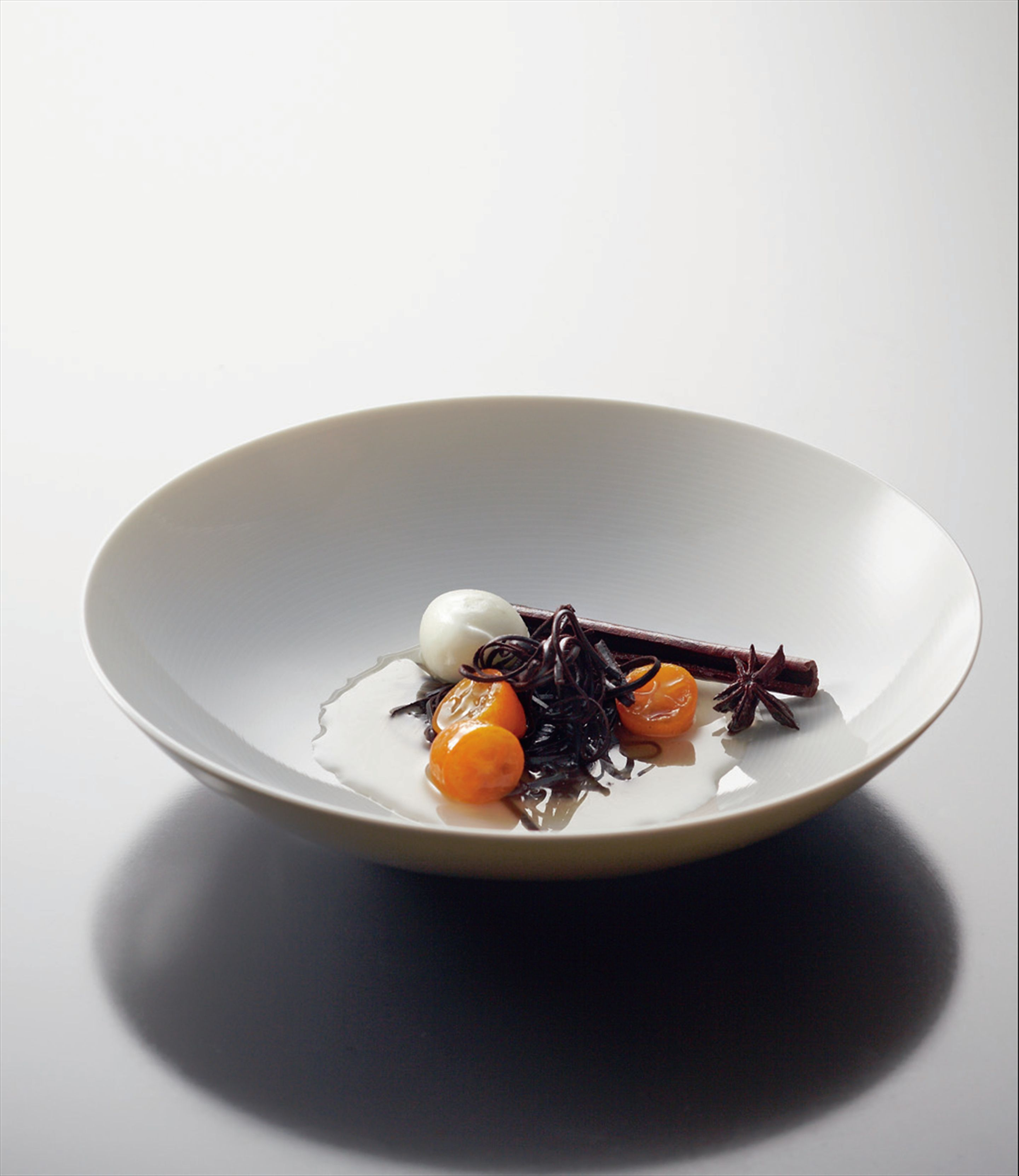 Chocolate vermicelli, cumquats and yoghurt