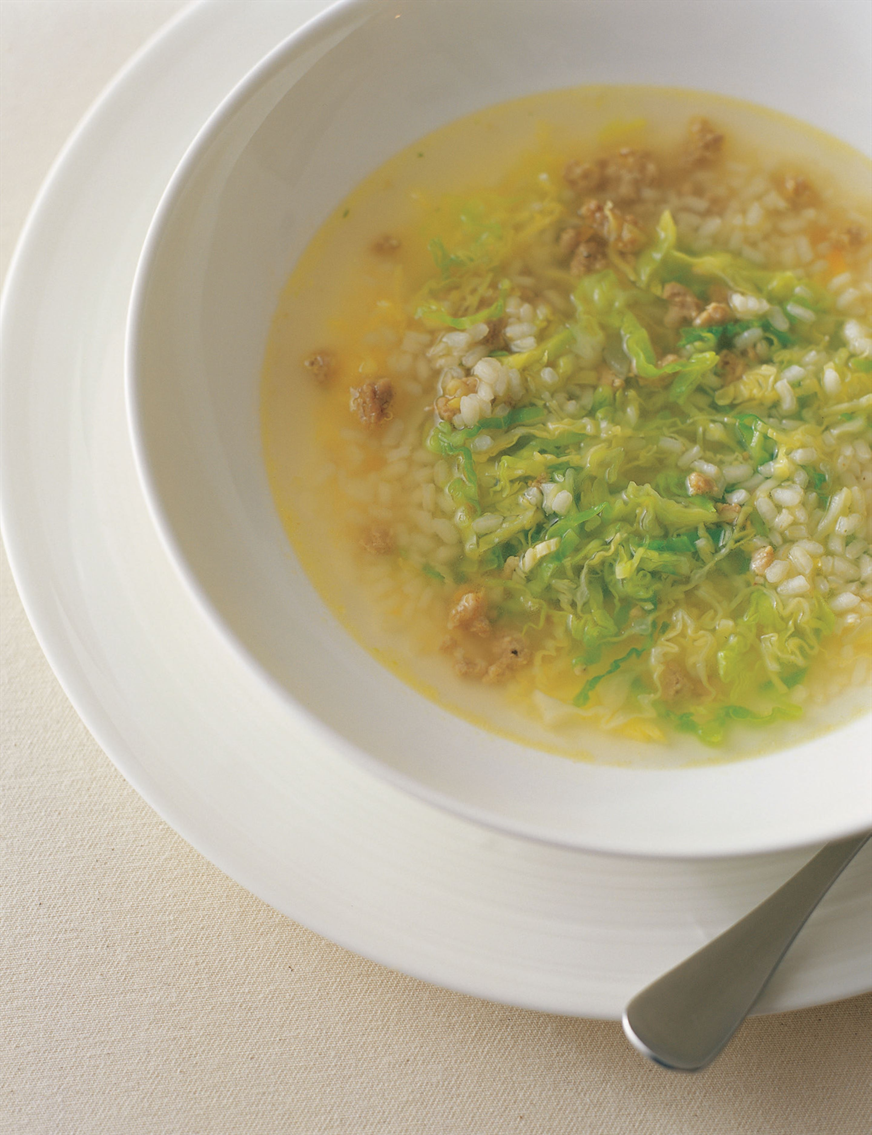 Rice soup with salame and cabbage