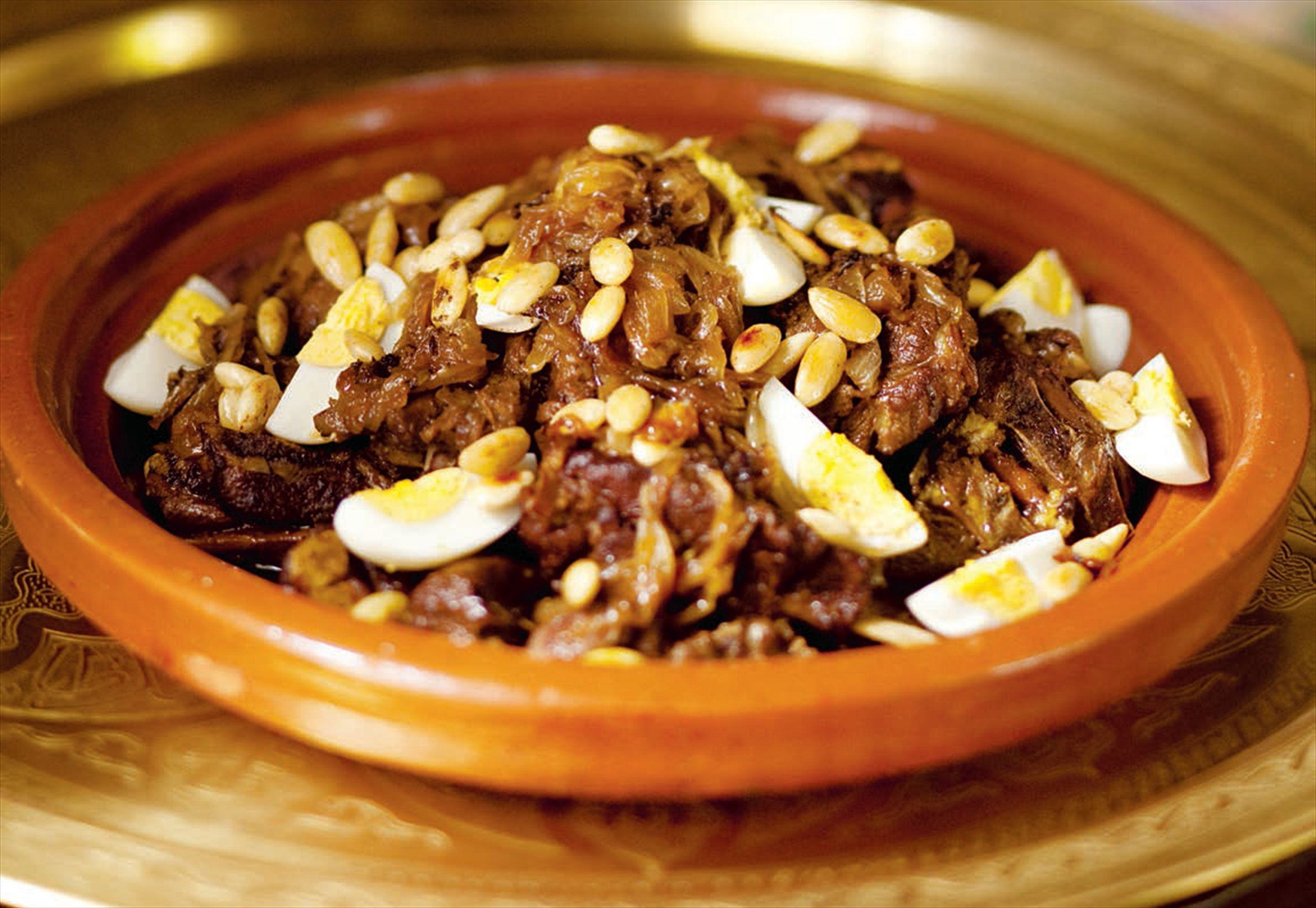 Lamb with onions, almonds and hard-boiled eggs