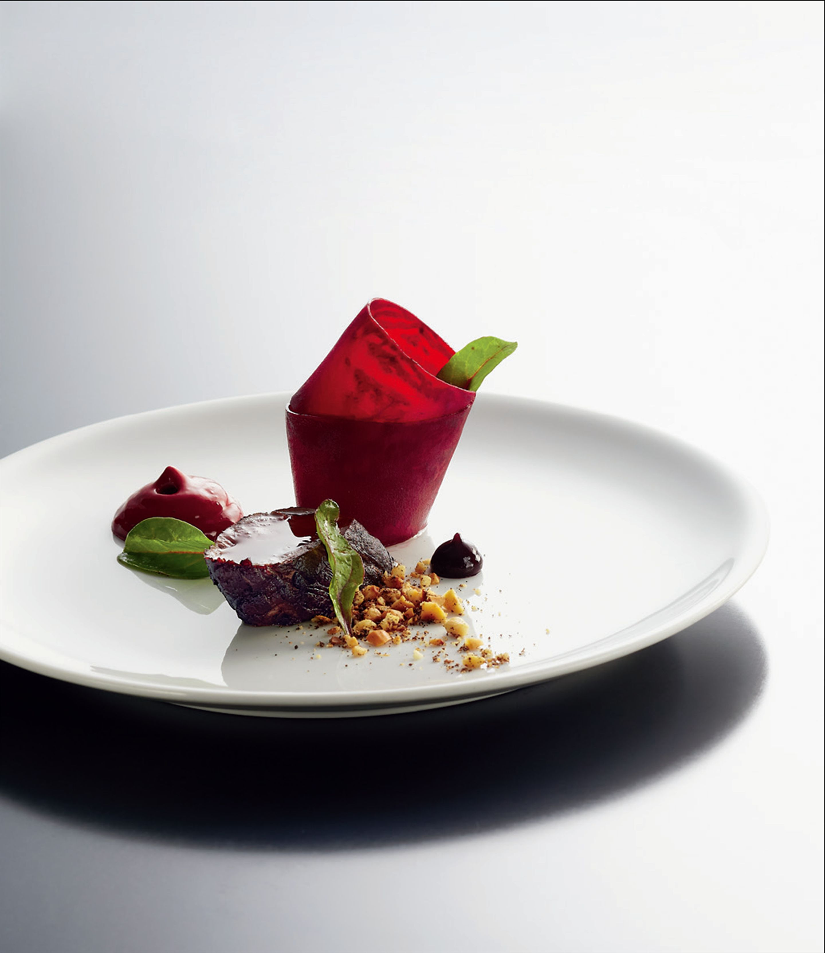 Venison tenderloin with beetroot and cocoa, and peanut and vanilla crumble