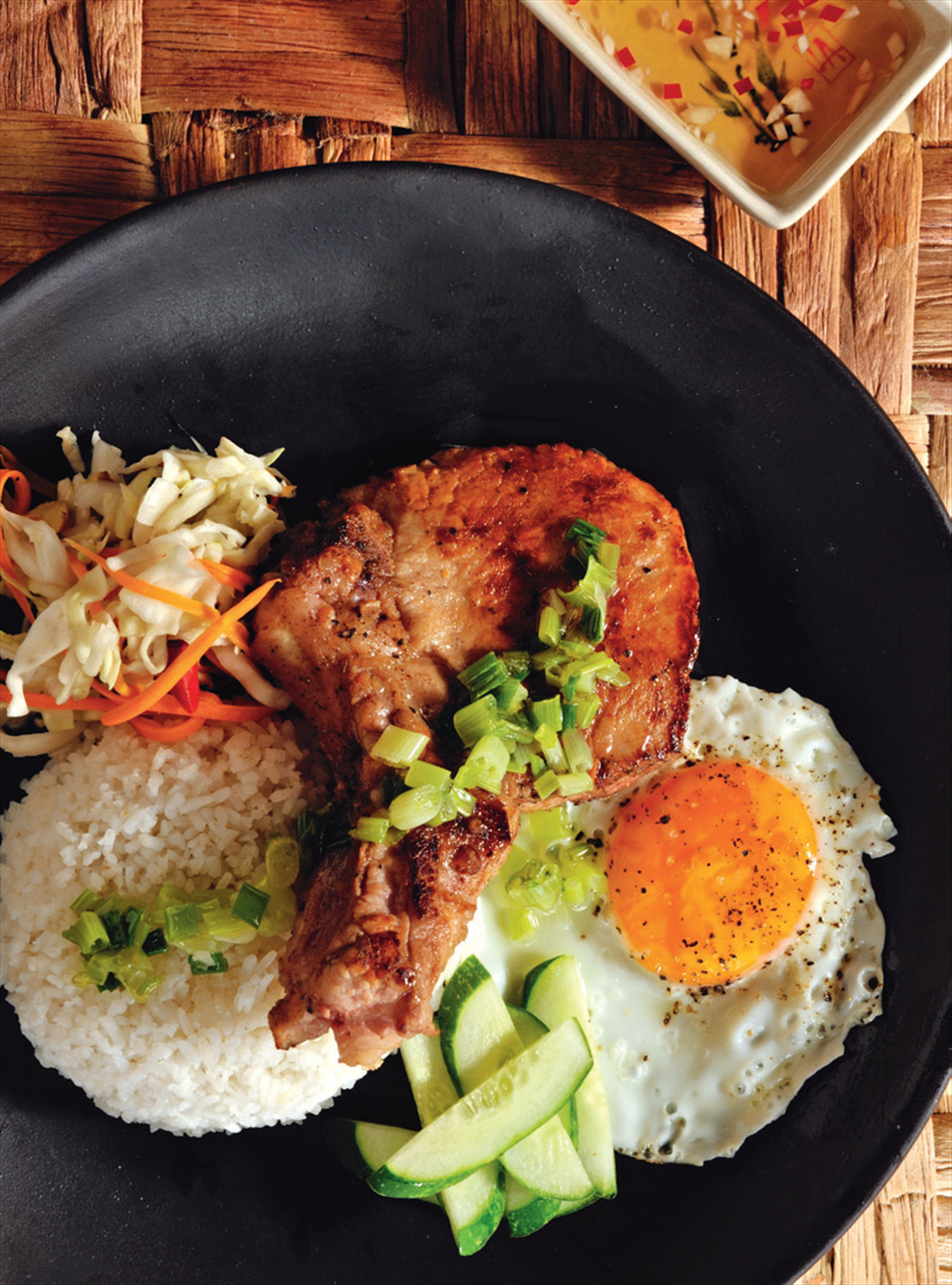 Broken rice with grilled pork and egg, sunny side up