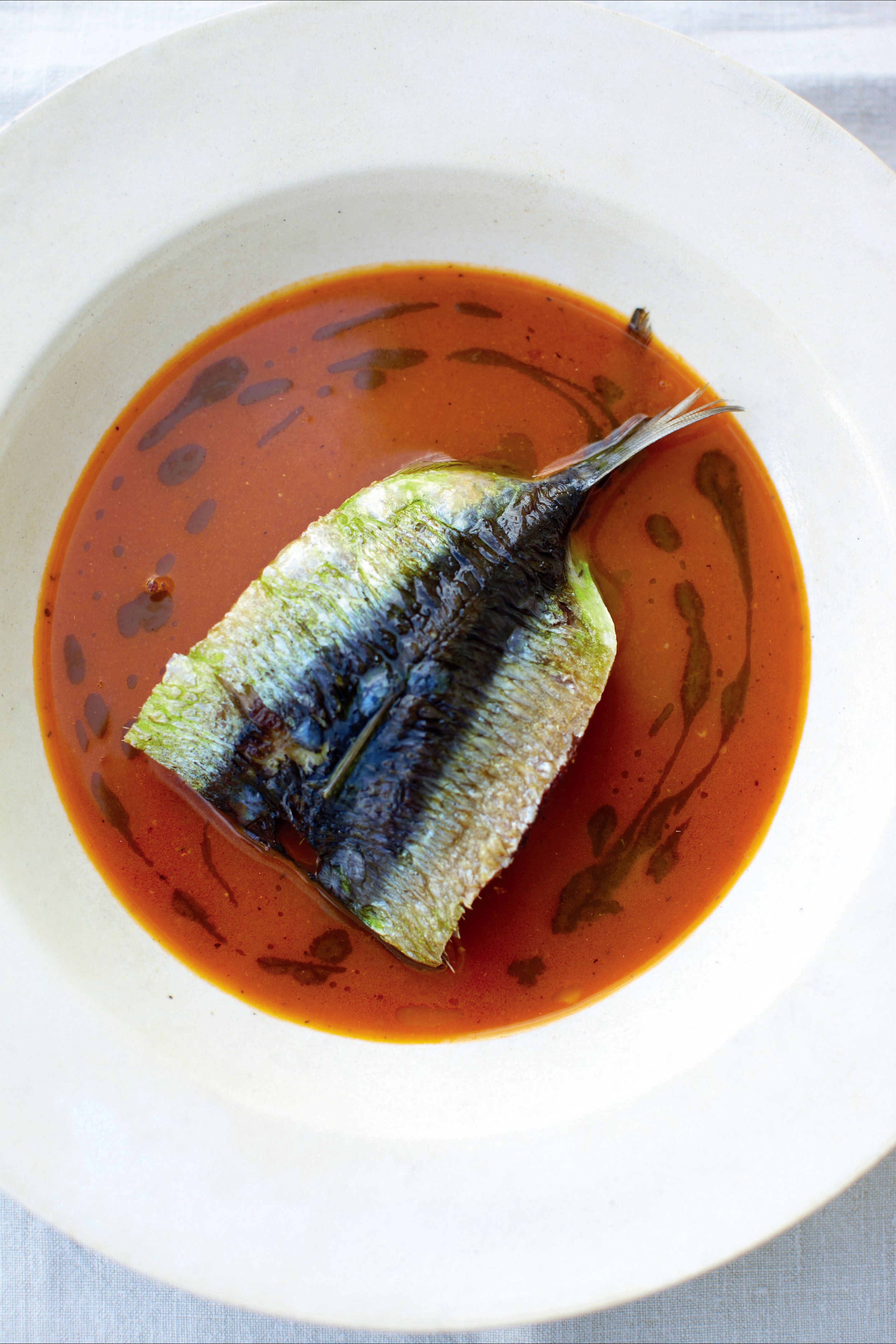 Sardine and tomato soup with basil oil
